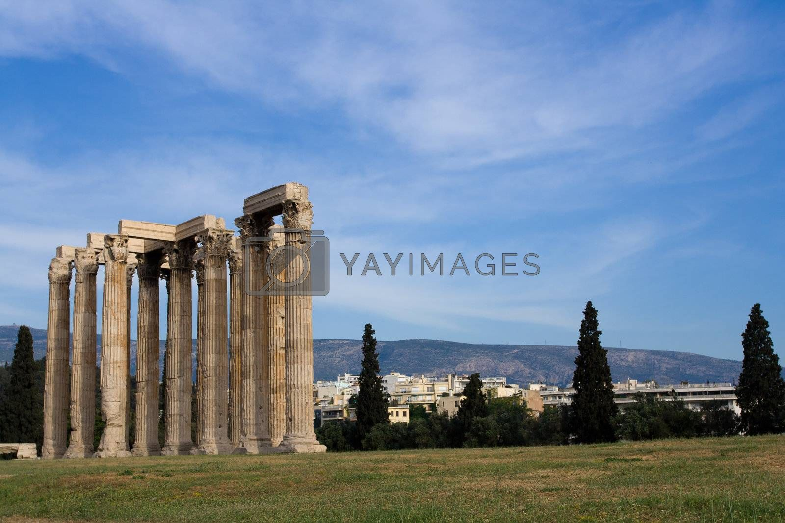 Ancient Temple of Olympian Zeus in Athens Greece on blue sky bac by SergeyAK