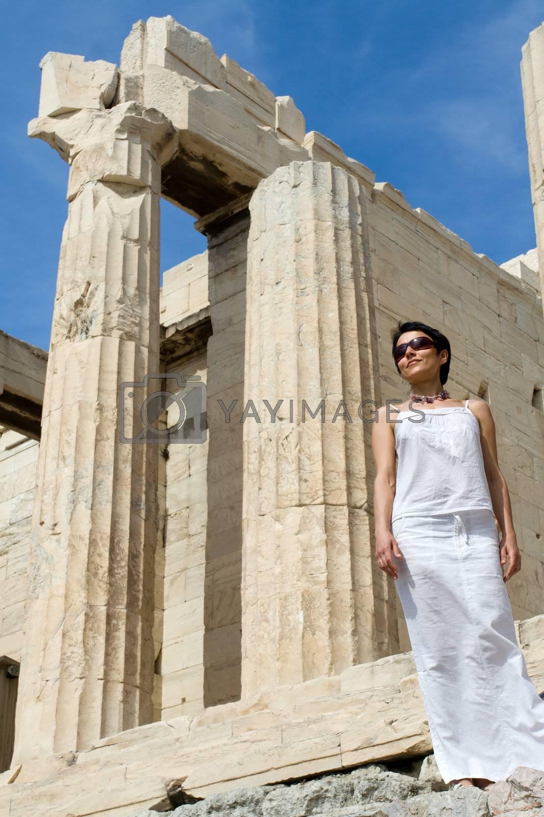 Woman near Propylaea Columns Acropolis Athens Greece on sky back by SergeyAK