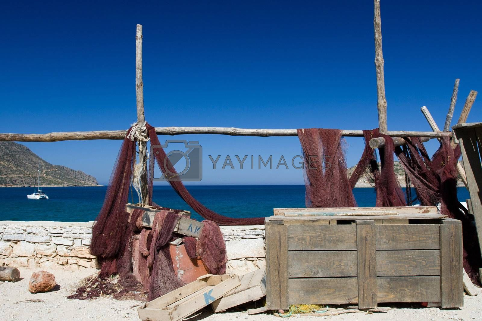 Picturesque marine landscape: fishing net and chest on sea mount by SergeyAK