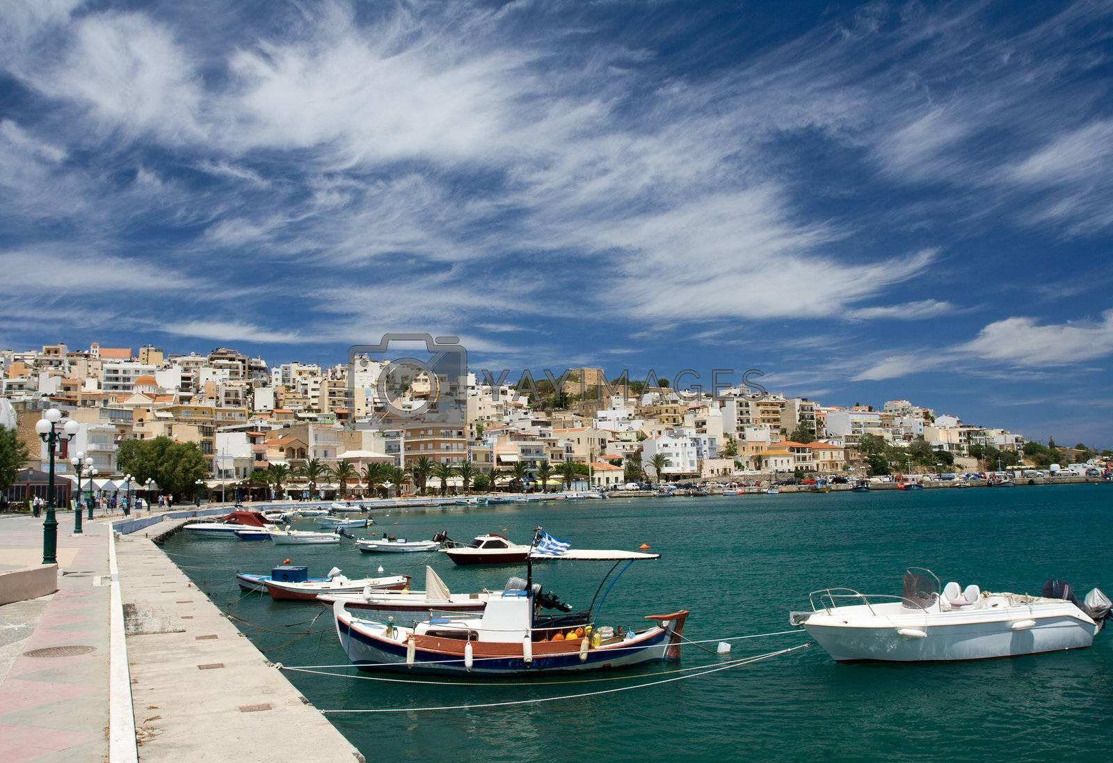 Sea bay, promenade in Mediterranean town and cirrus clouds by SergeyAK