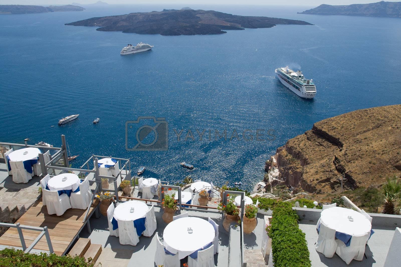 Seascape on volcanic caldera as seen from the restaurants' terrace along cliffs in Fira, Santorini island capital, Greece
