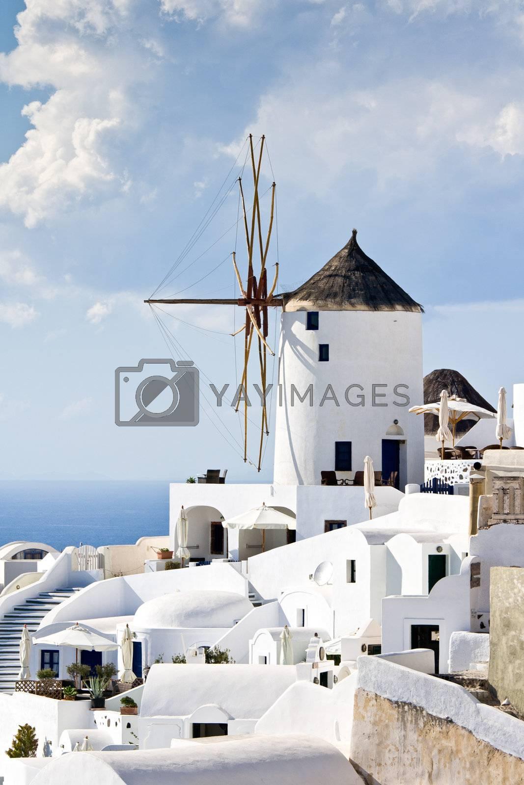 Traditional windmills in village Oia of Cyclades island Santorin by SergeyAK