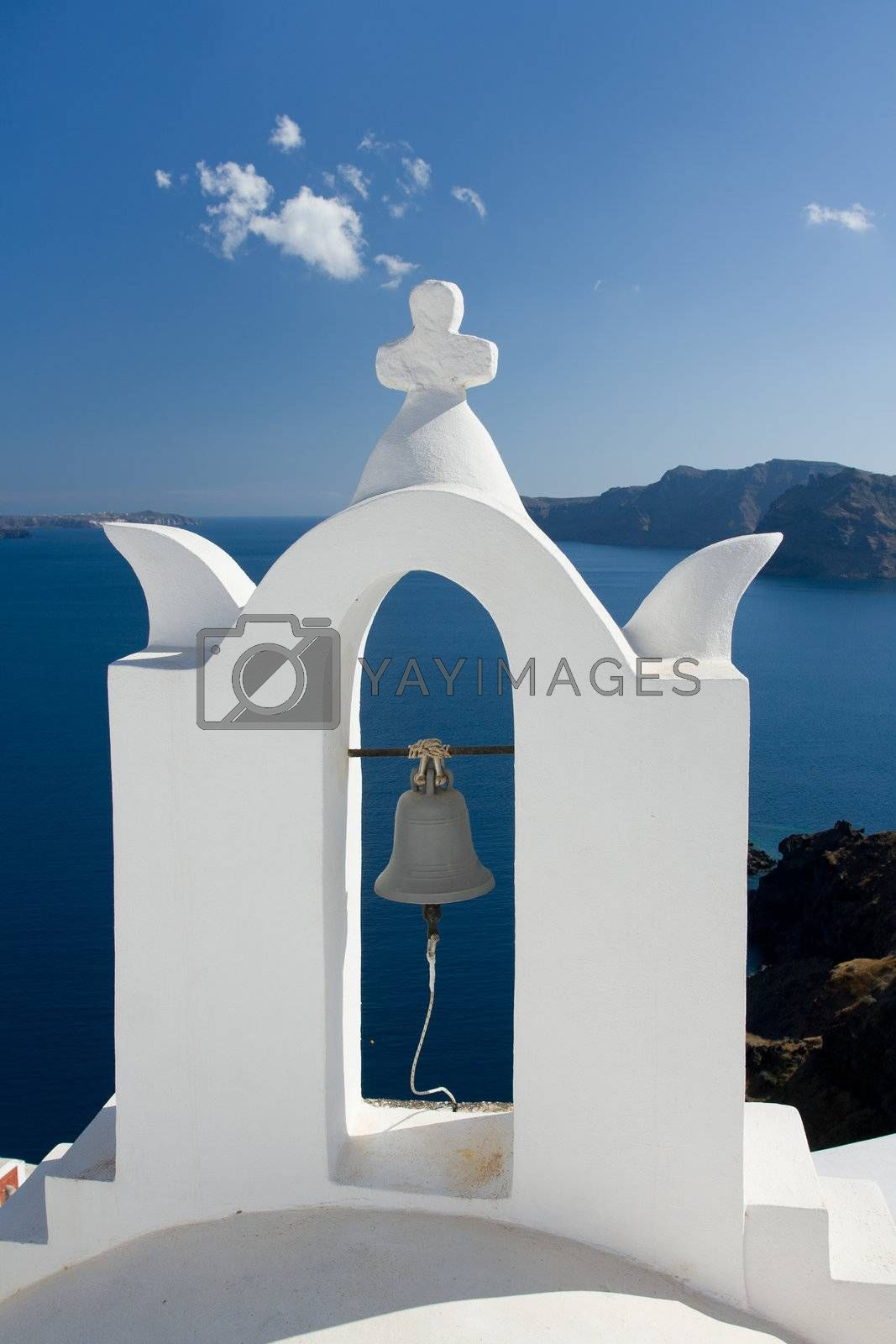 See view through white church arch and bell Santorini Greece   by SergeyAK