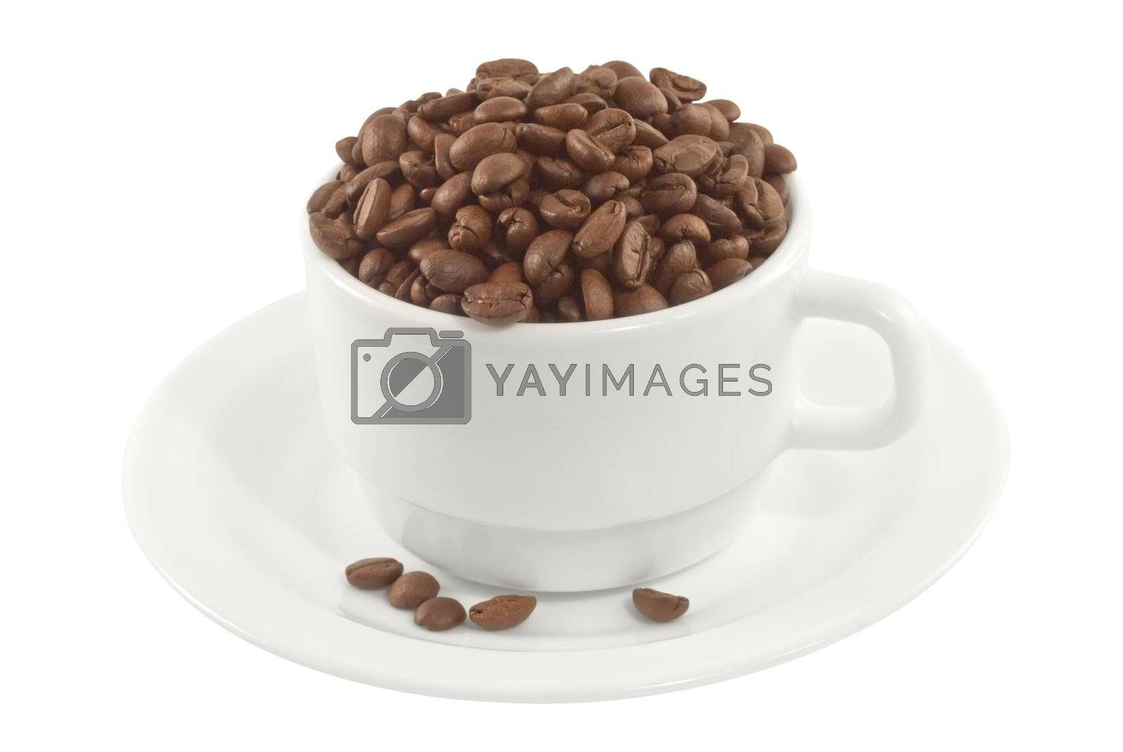 Cup and saucer full of coffee beans, side view by alexvav