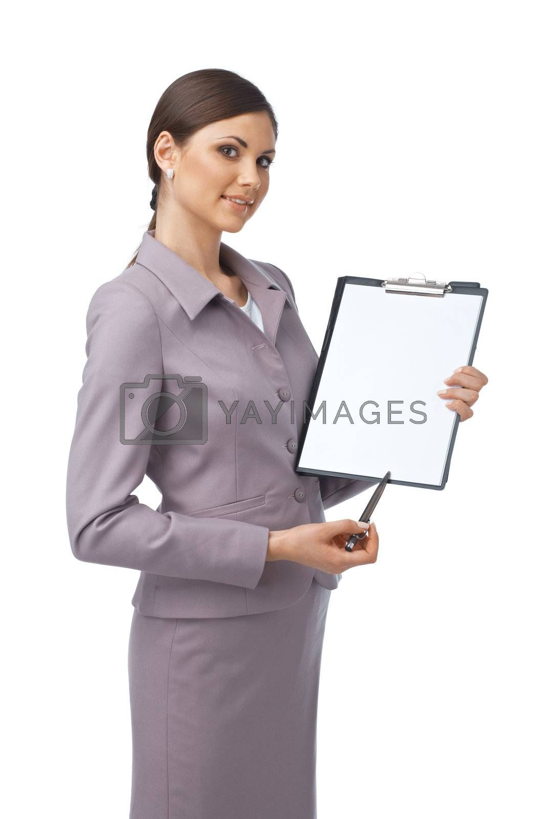 Portrait of a young business woman pointing with a pen on the paper she is holding