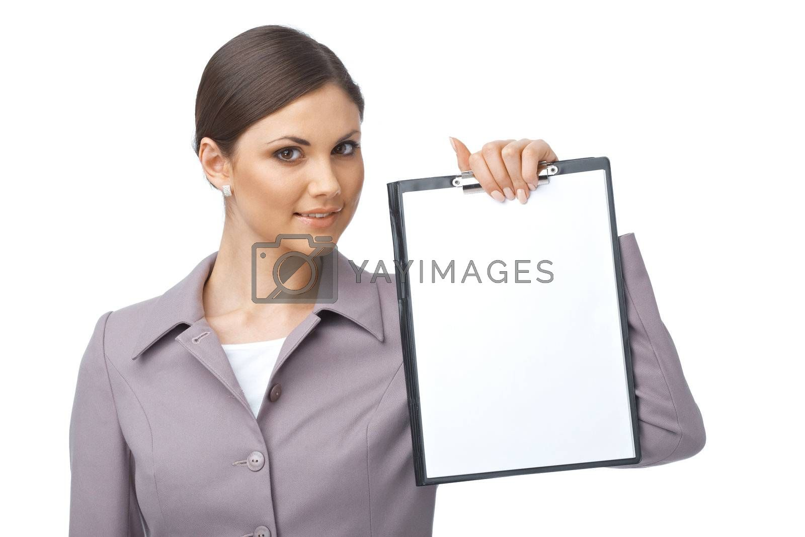 Businesswoman holding an empty clipboard over white background