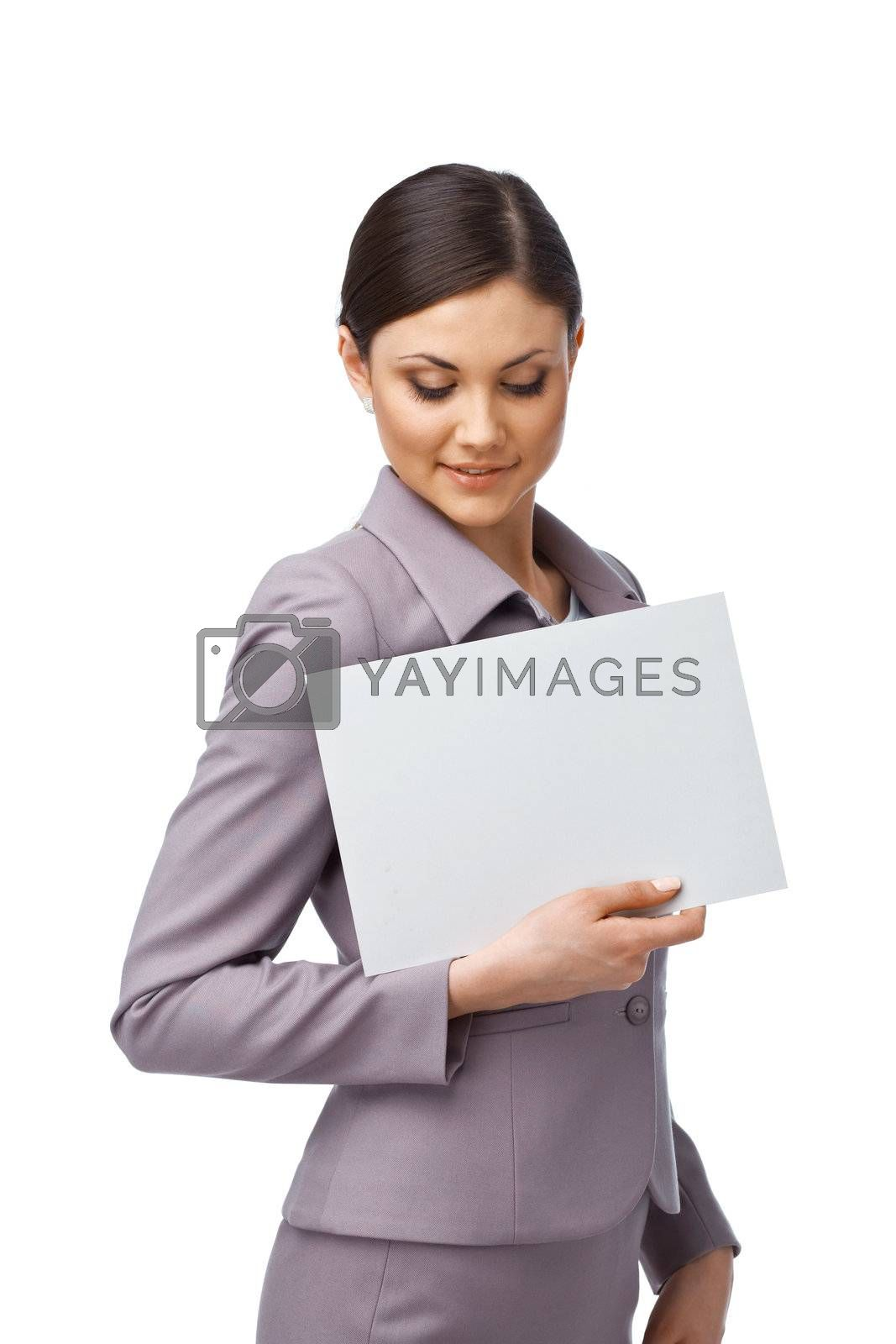 Portrait of an attractive young business woman holding an empty billboard