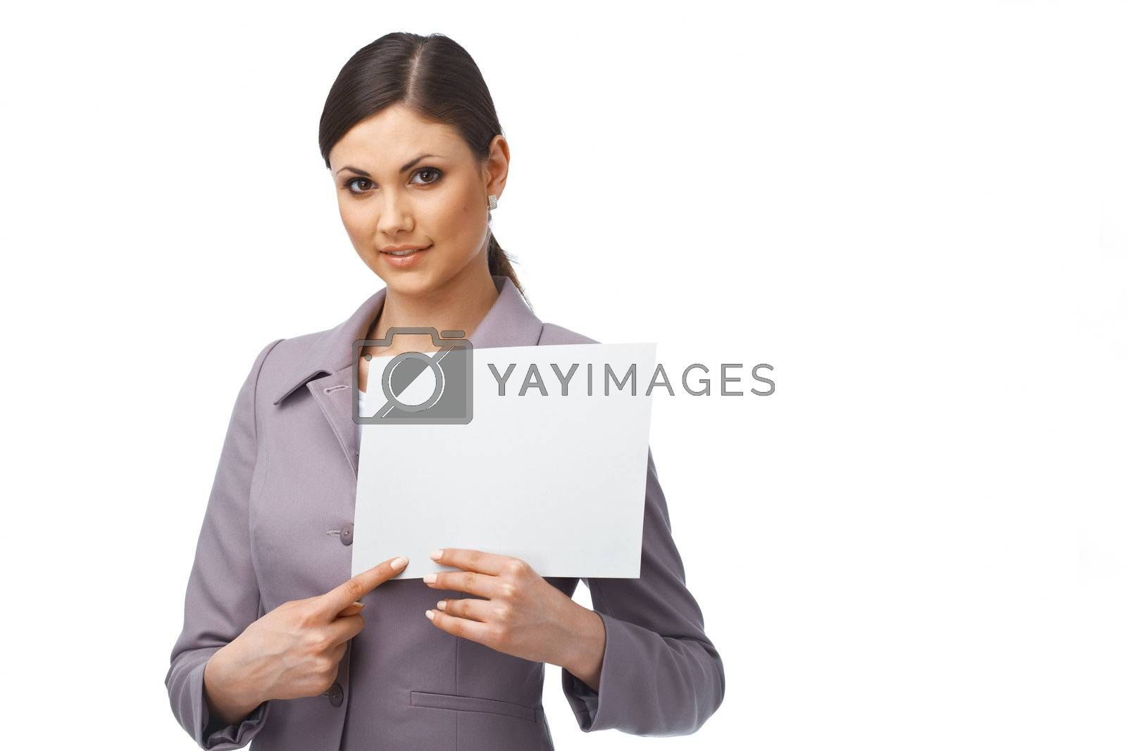 Portrait of a young business woman pointing on the paper she is holding