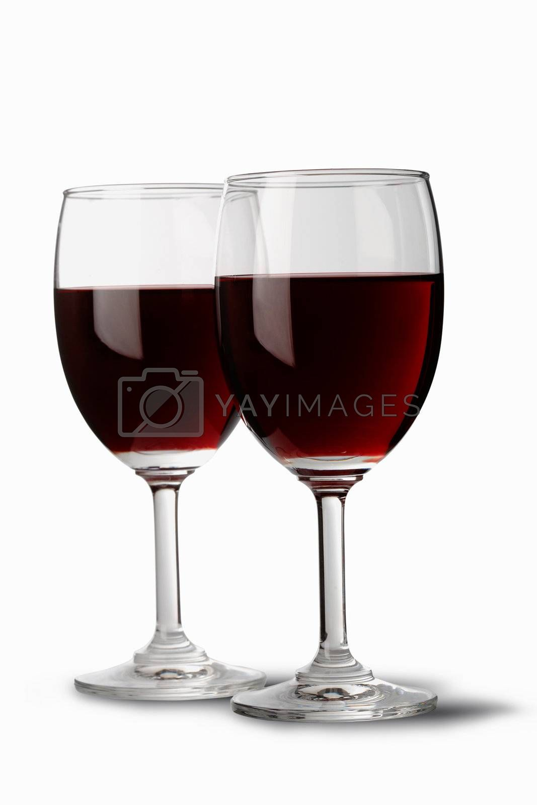 Two red wine glasses by romanshyshak