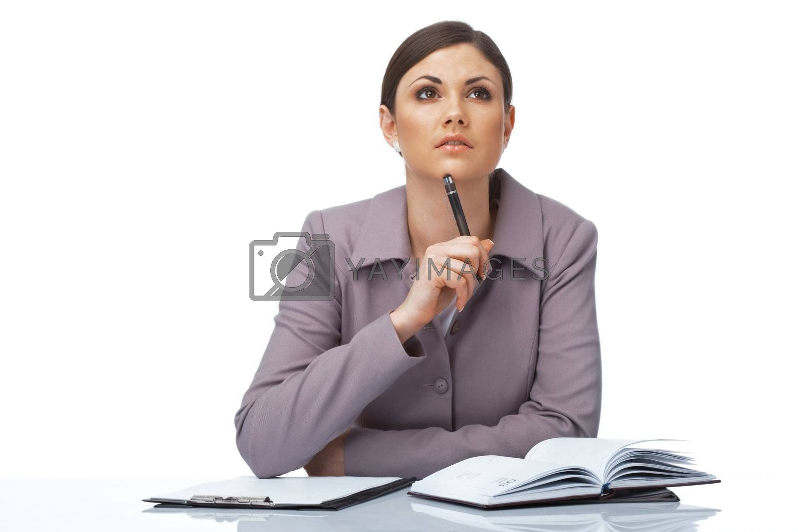 Portrait of a thoughtful young businesswoman with pen and notebook