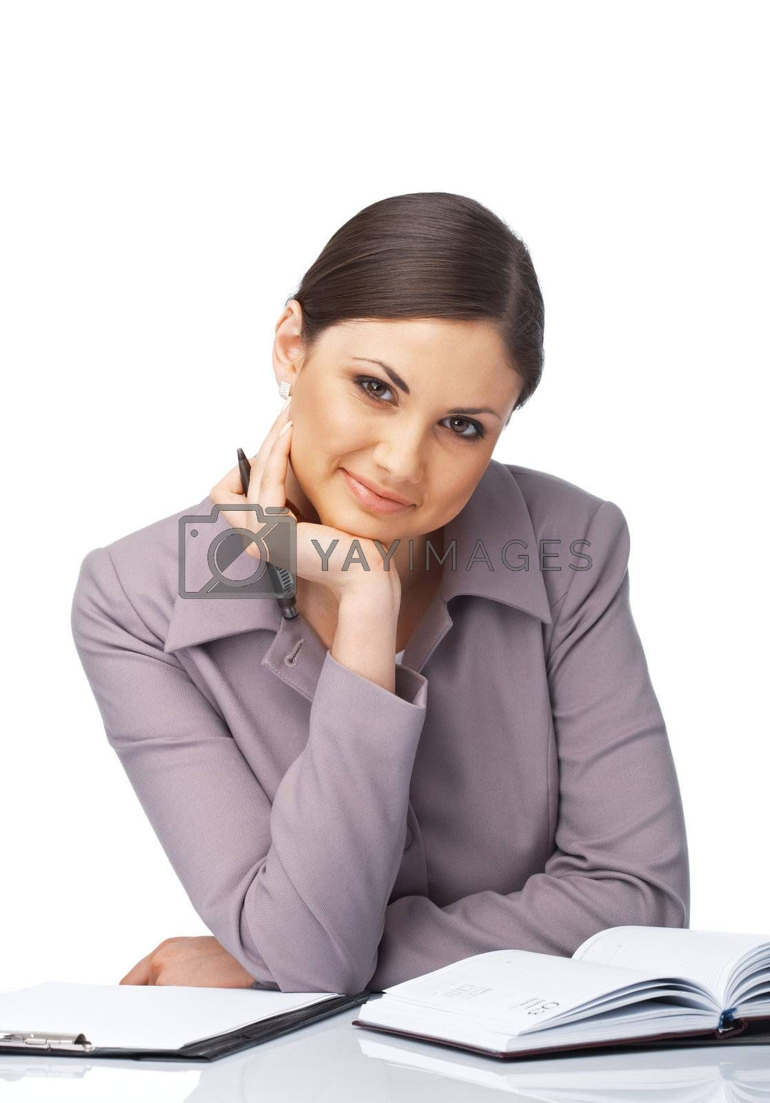 Portrait of a young businesswoman at the desk with her chin on the hand