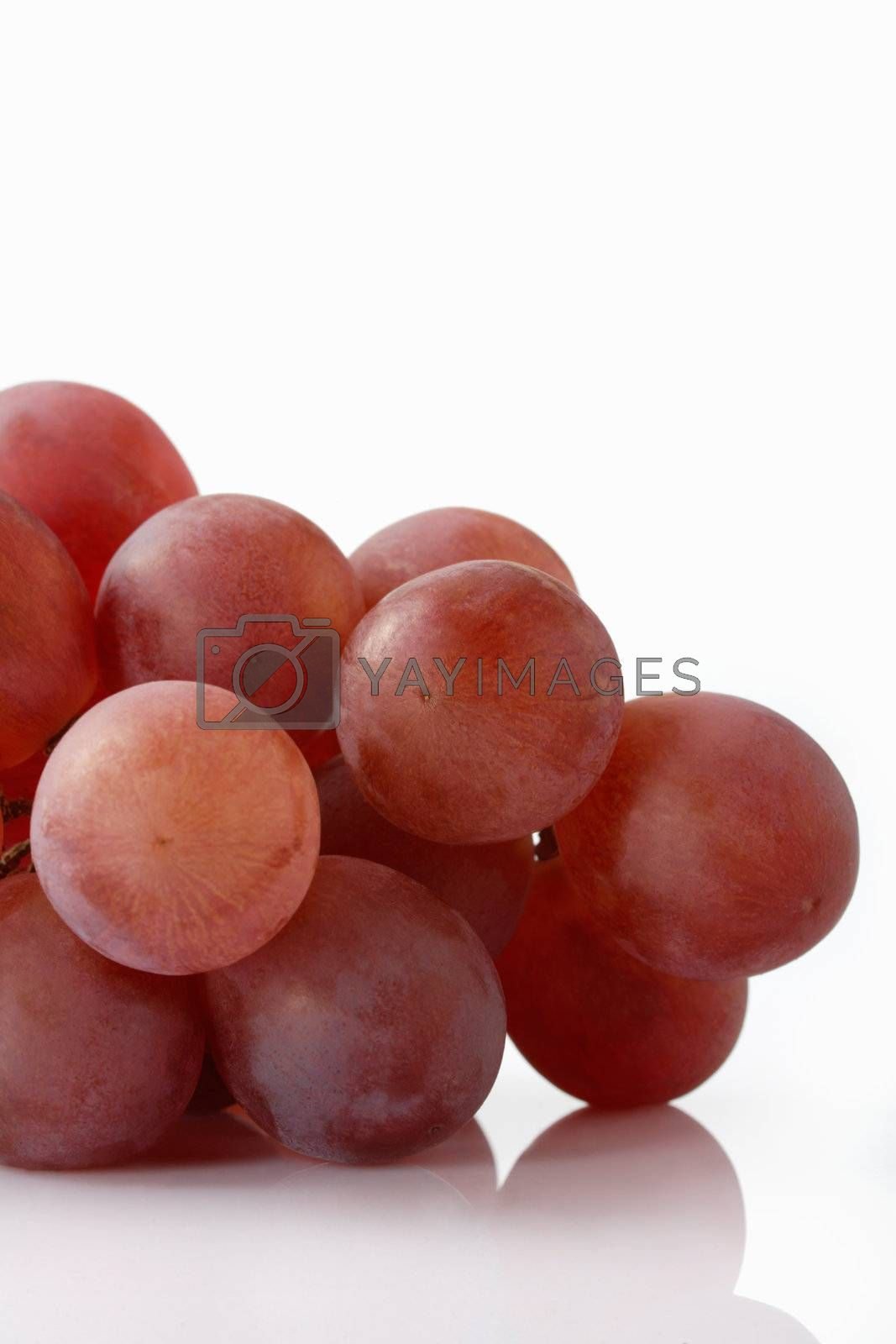 Red Grapes heap on white background