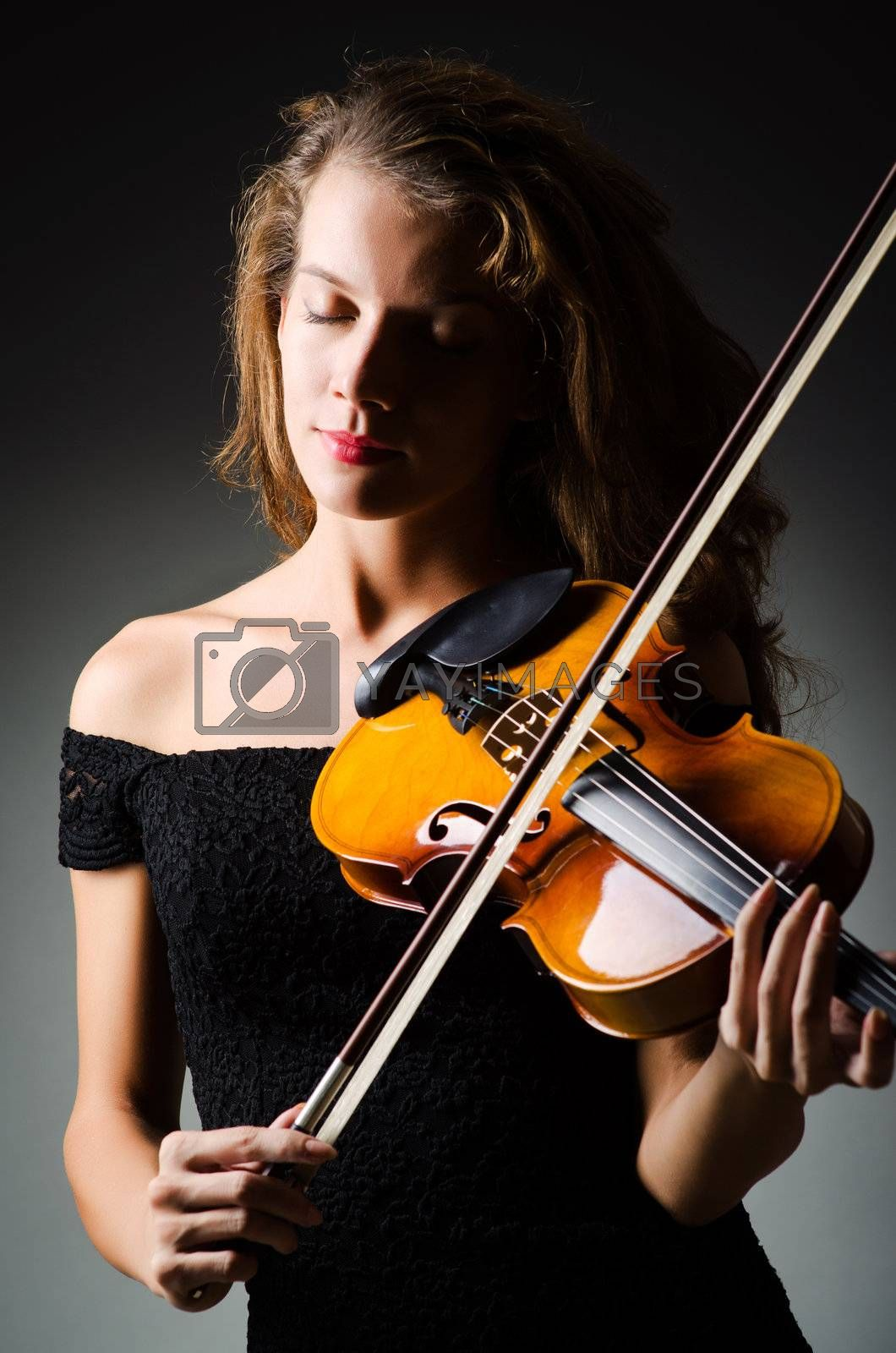 Woman with violin in dark room by Elnur