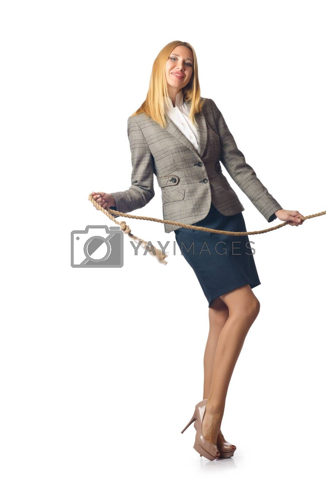 Businesswoman in tug of war concept by Elnur