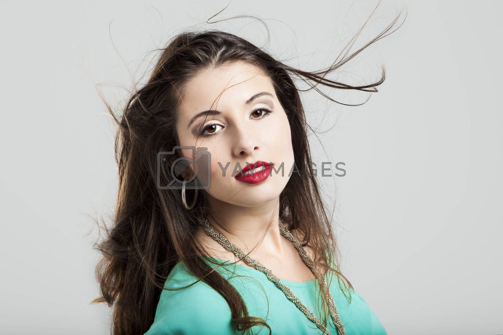 Portrait of a beautiful and atractive fashion woman on a grey background