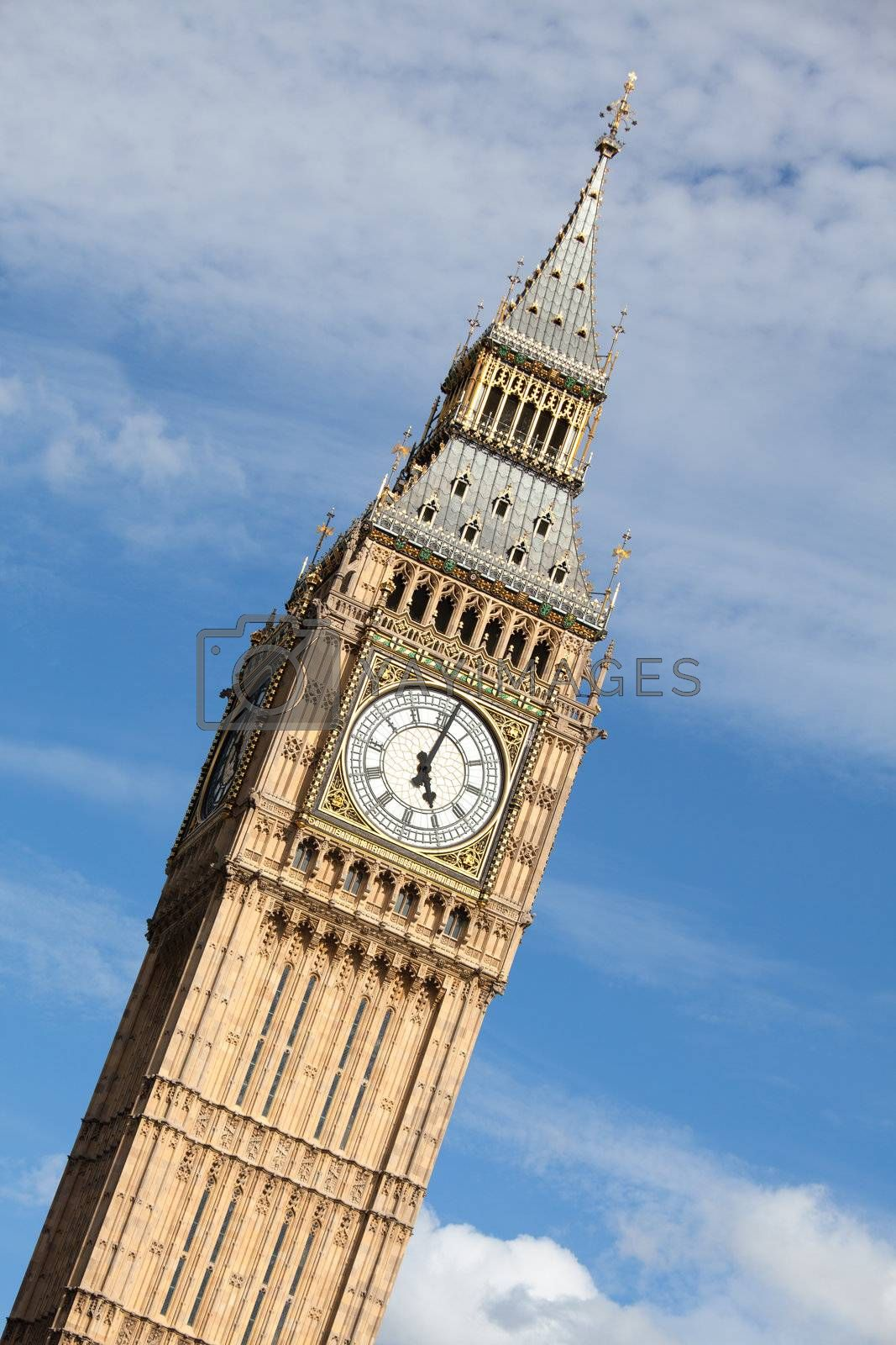 Britain national symbol Clock Big Ben (Elizabeth tower in Gothic Revival style) at 5 o'clock on cloudy sky background in London