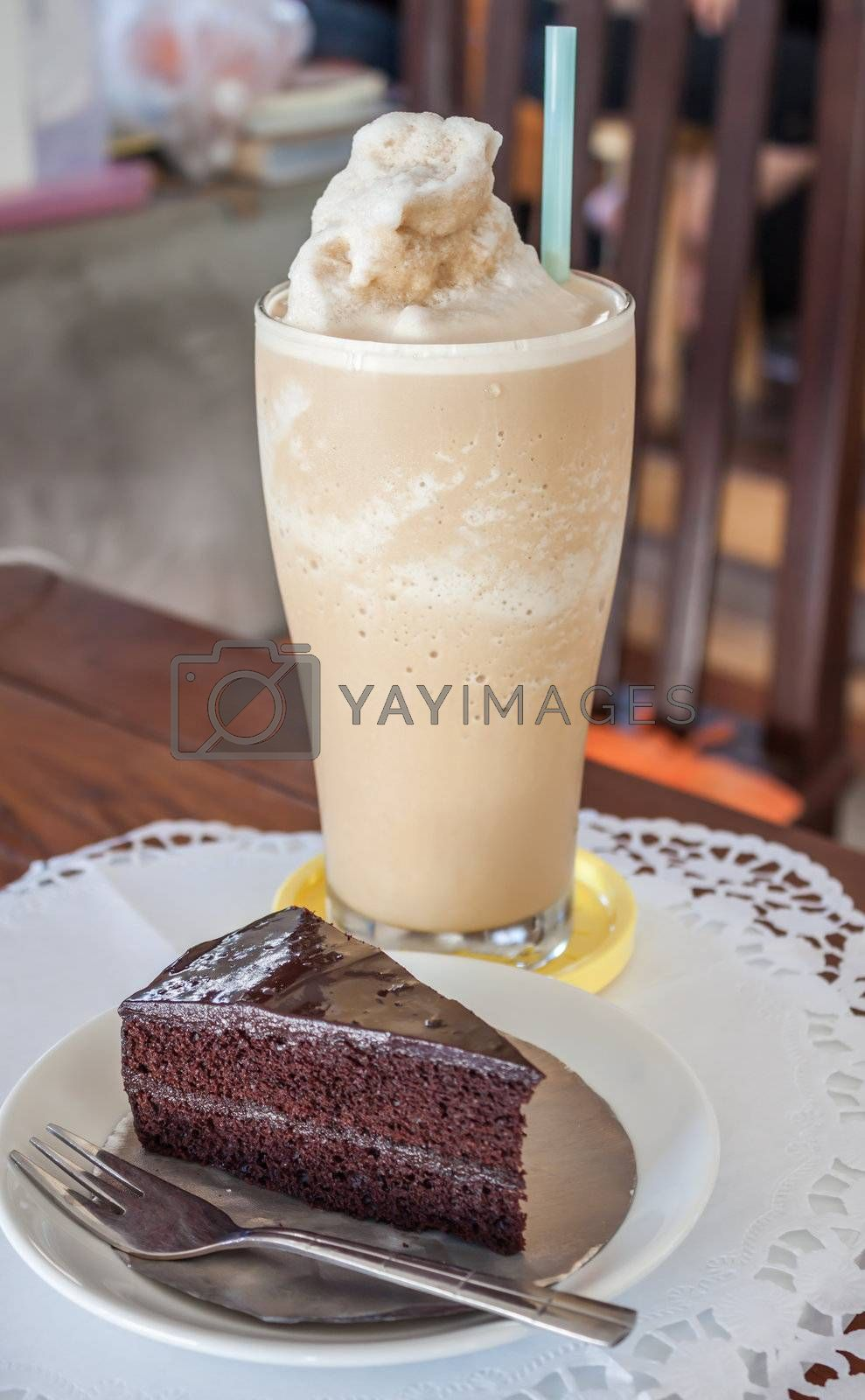 A set of coffee frappe and chocolate cake on the table