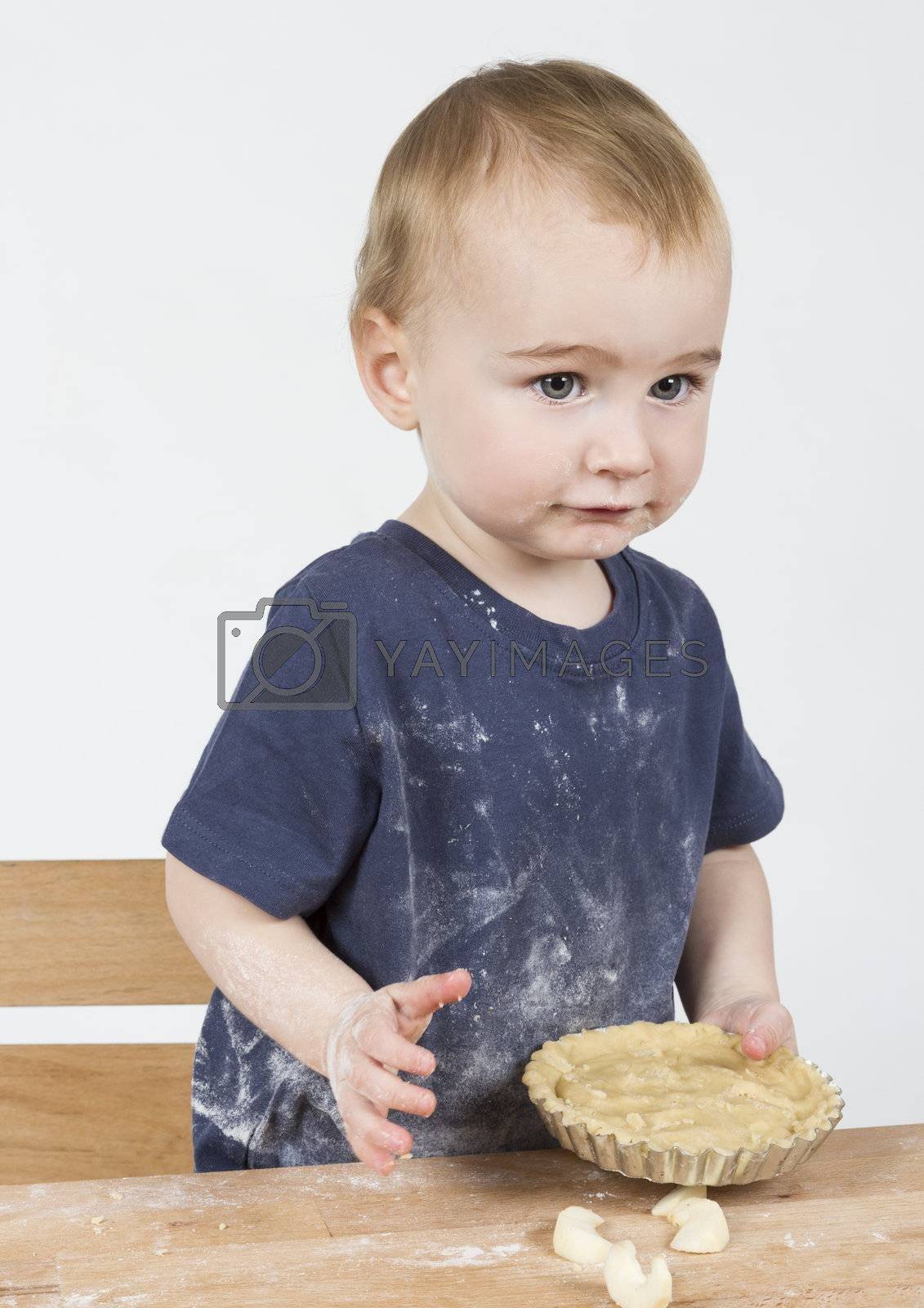 Royalty free image of child making cookies by gewoldi