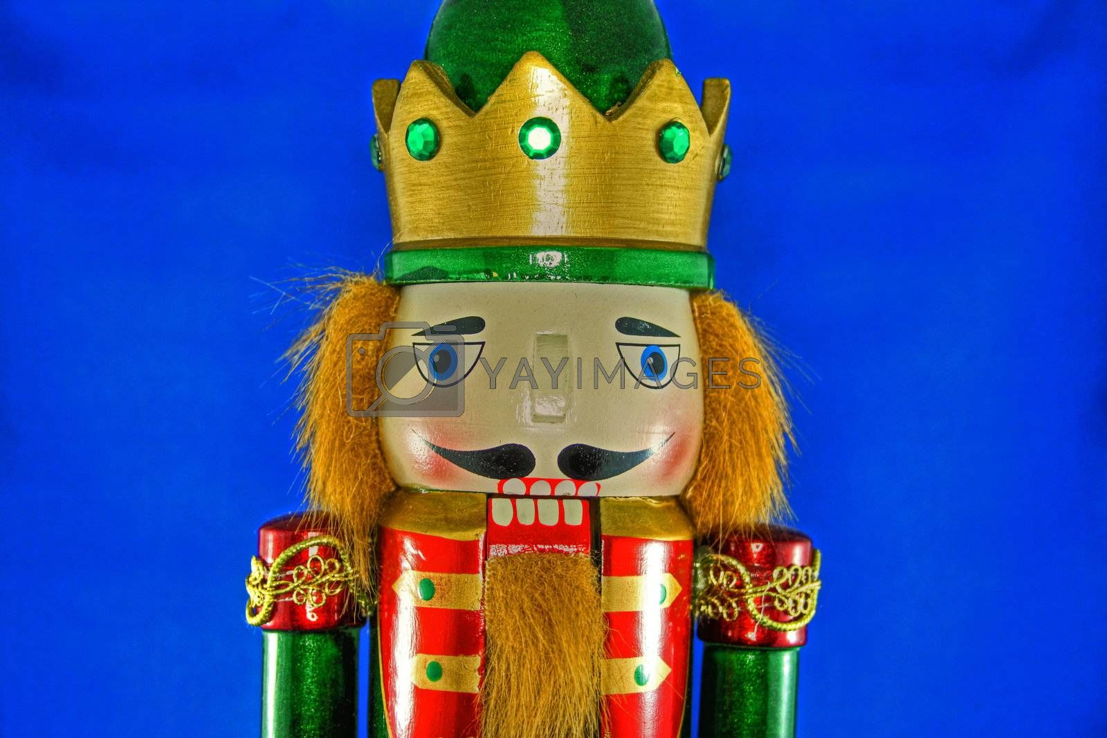 Close up view of Nutcracker on blue background