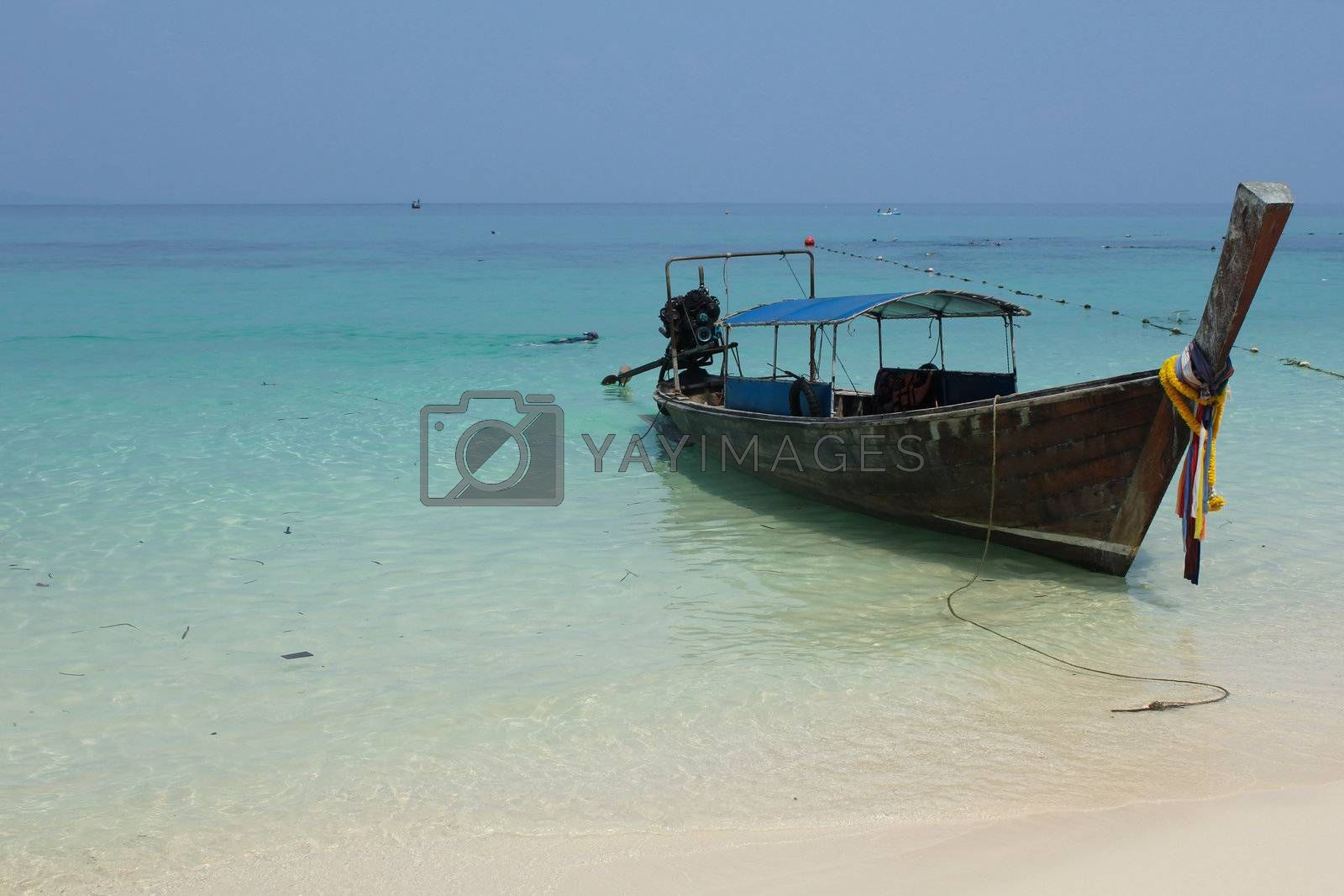 Long tail boat by the beach