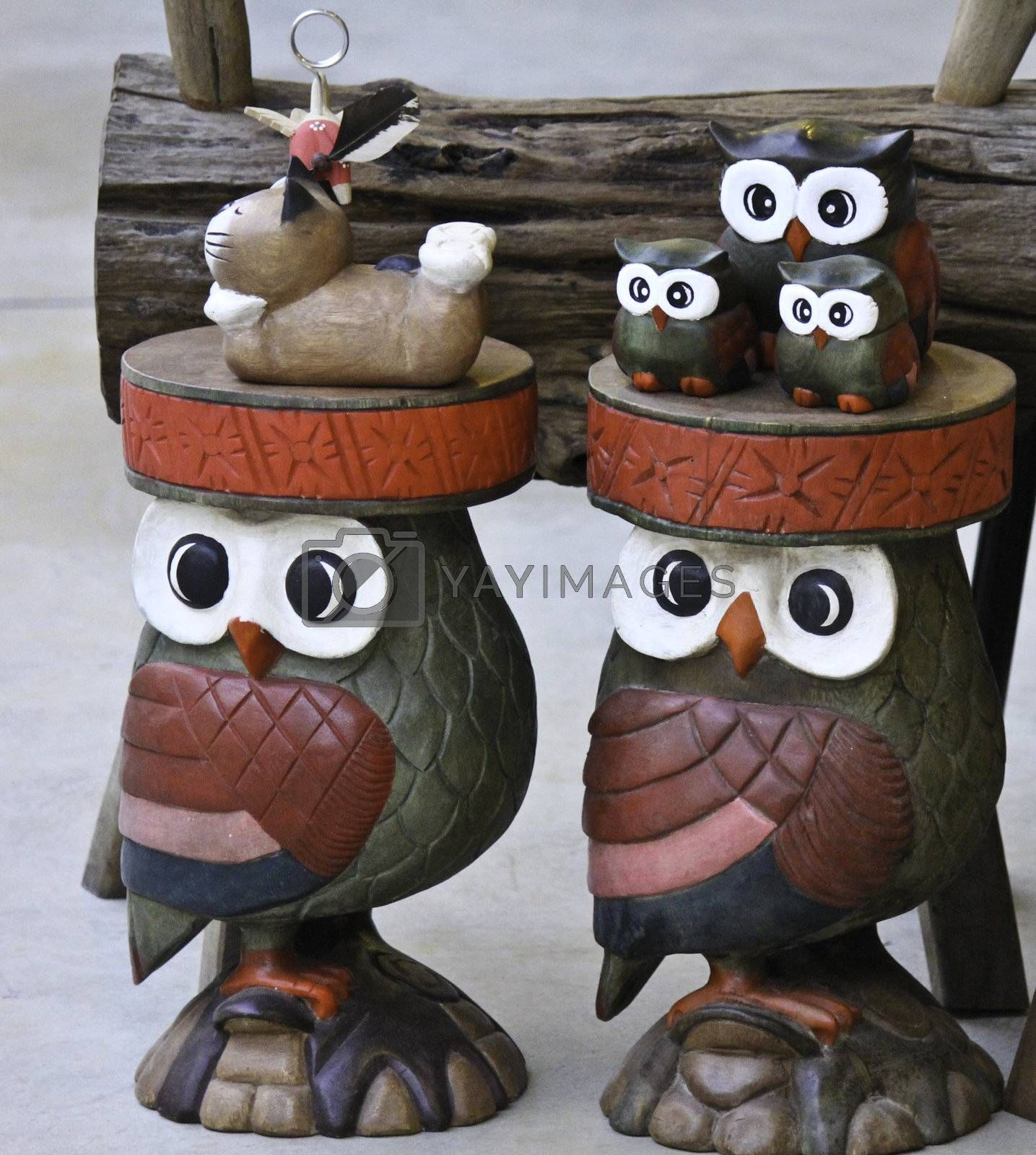 wooden owl in brown color