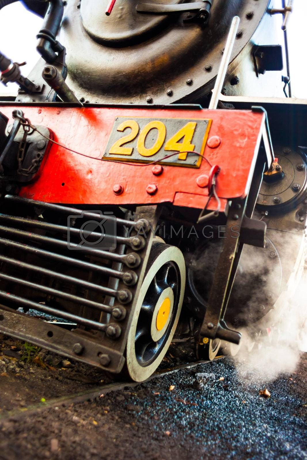 Wheels and cowcatcher of a steam locomotive