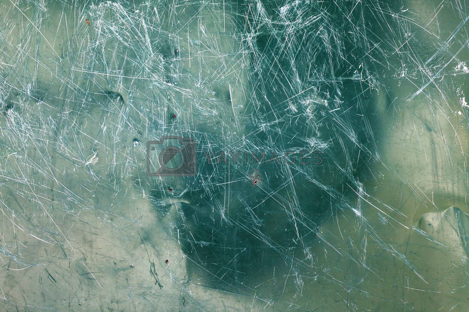 Image of green glass texture close-up with scratches over surface