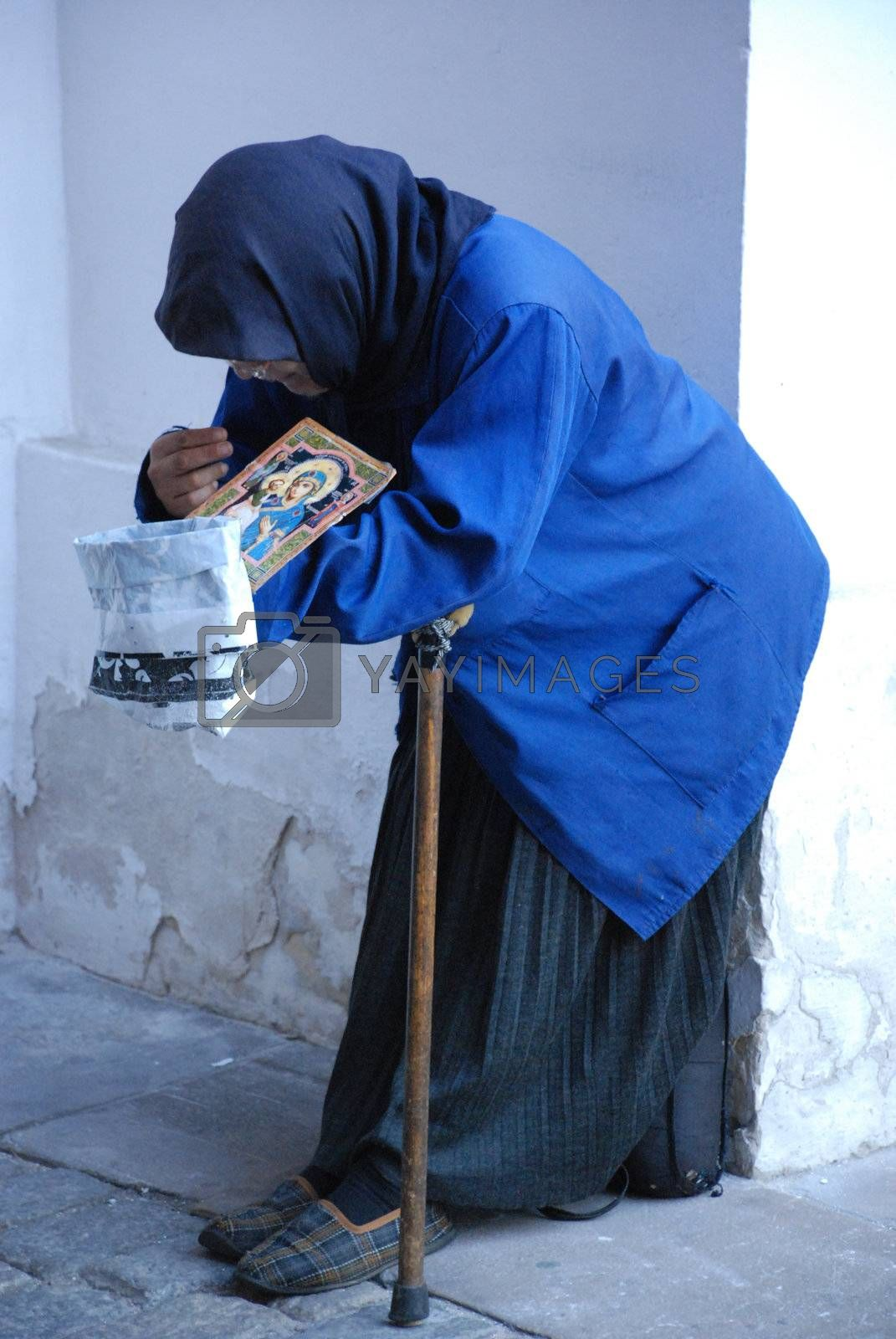 Royalty free image of Begging woman by danemo