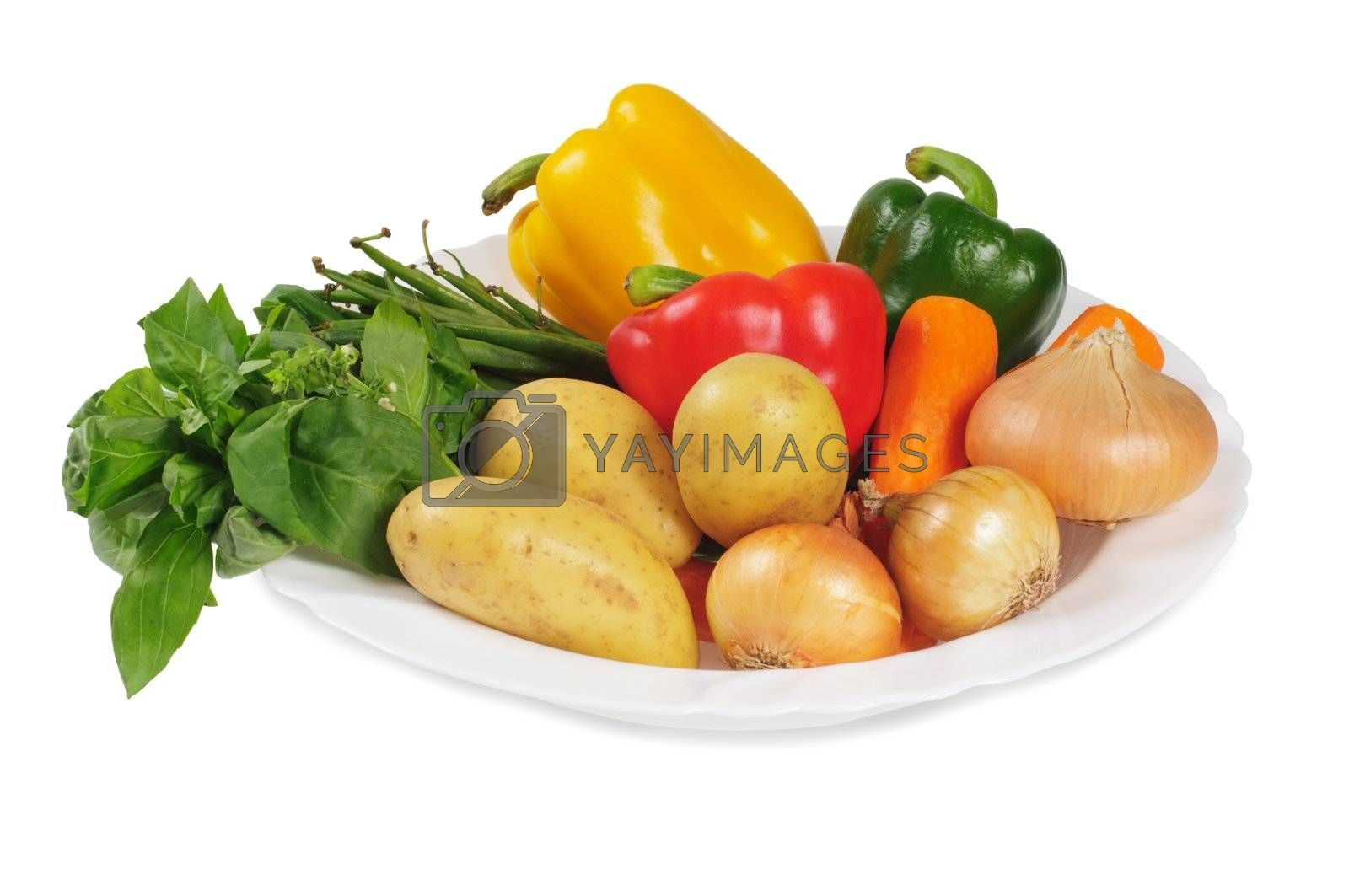 Plate with vegetables for a salad. Bell peppers, potatoes, onions, carrots and herbs. Isolated on white.