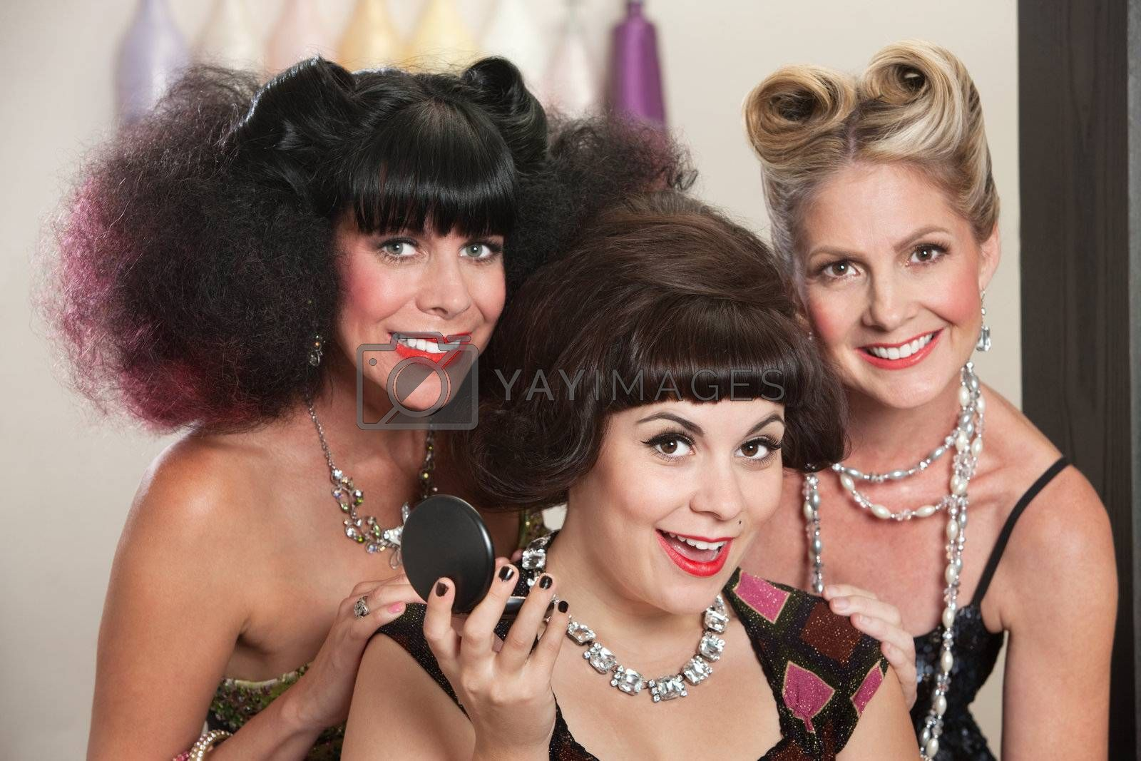 Three joyful Caucasian females in beauty salon