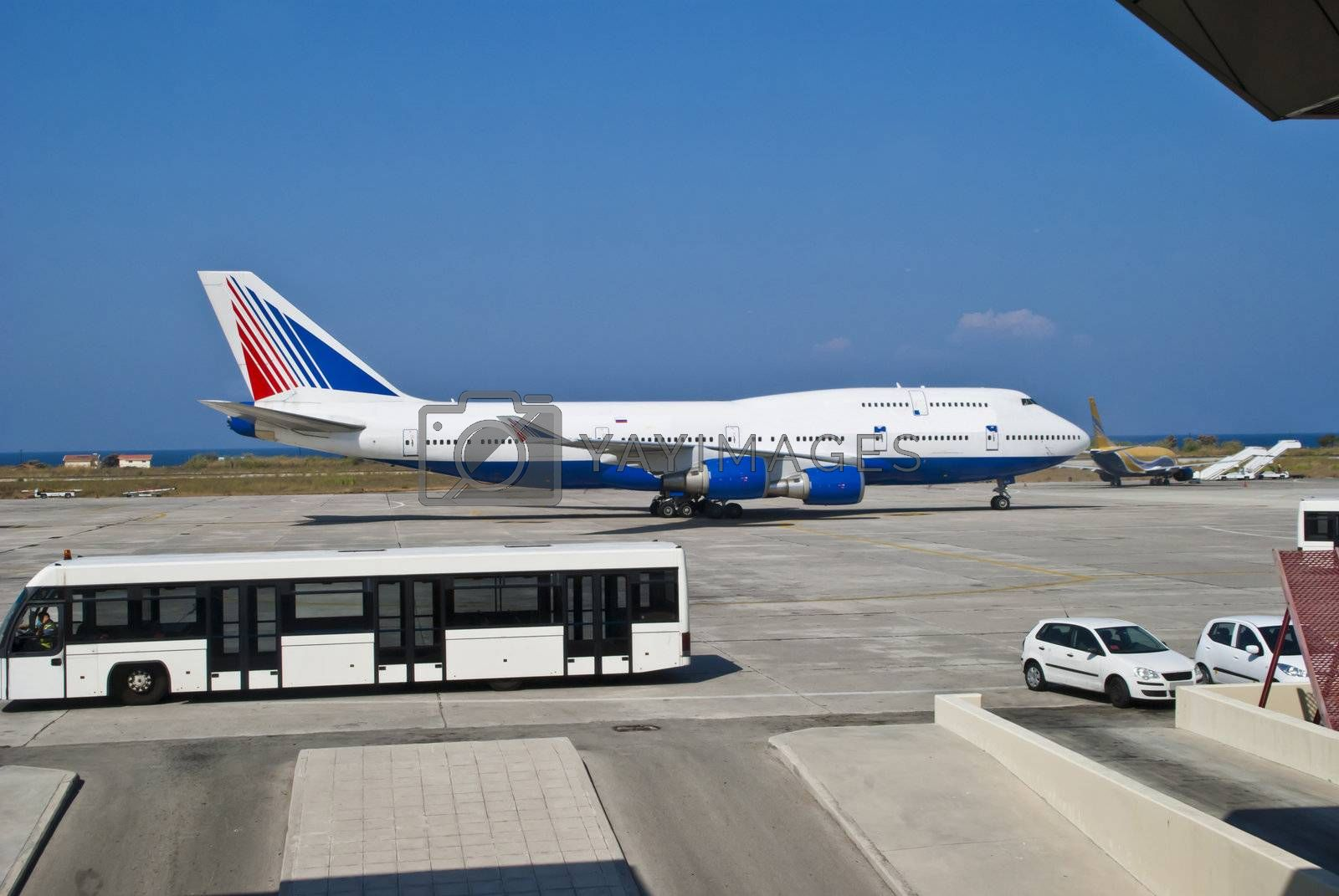 Boeing 747, also known by the nickname Jumbojet, is the world's second largest passenger aircraft after Airbus A380. Picture are shot from the departure hall at Rhodes airport.