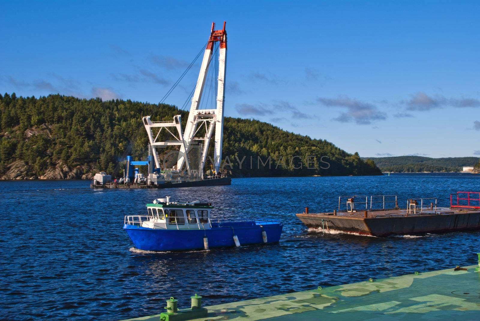 """photo is shot from the pier at halden harbor, floating crane """"taklift"""" depart from halden harbor, some details: seagoing floating crane, 400 tonns lift capacity, imo: 8639431, mmsi: 257796900, flag: norway, gross tonnage:994 tons, build year:1974."""