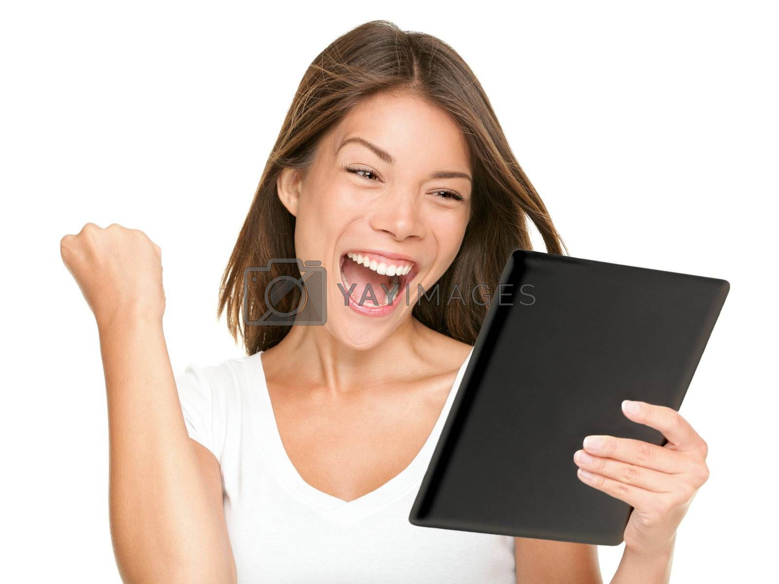 Tablet computer woman winning happy excited looking at screen isolated on white background. Joyful fresh and energetic multiracial young woman.