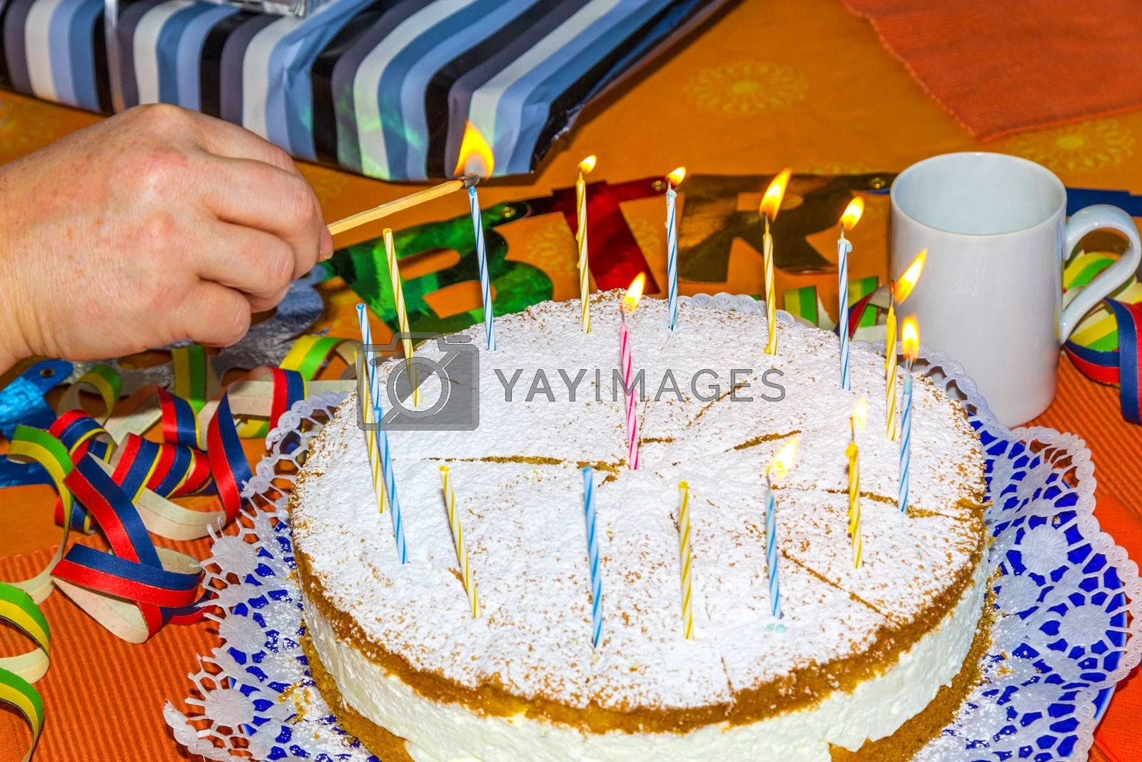 lighting the birthday candles on the cake