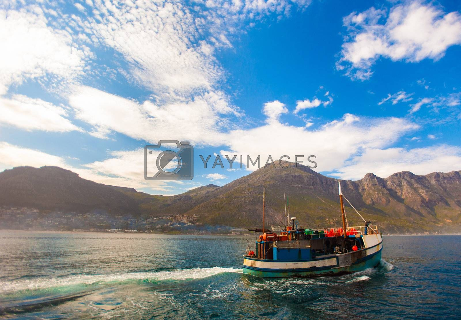 Fishing boat steaming out of Hout Bay