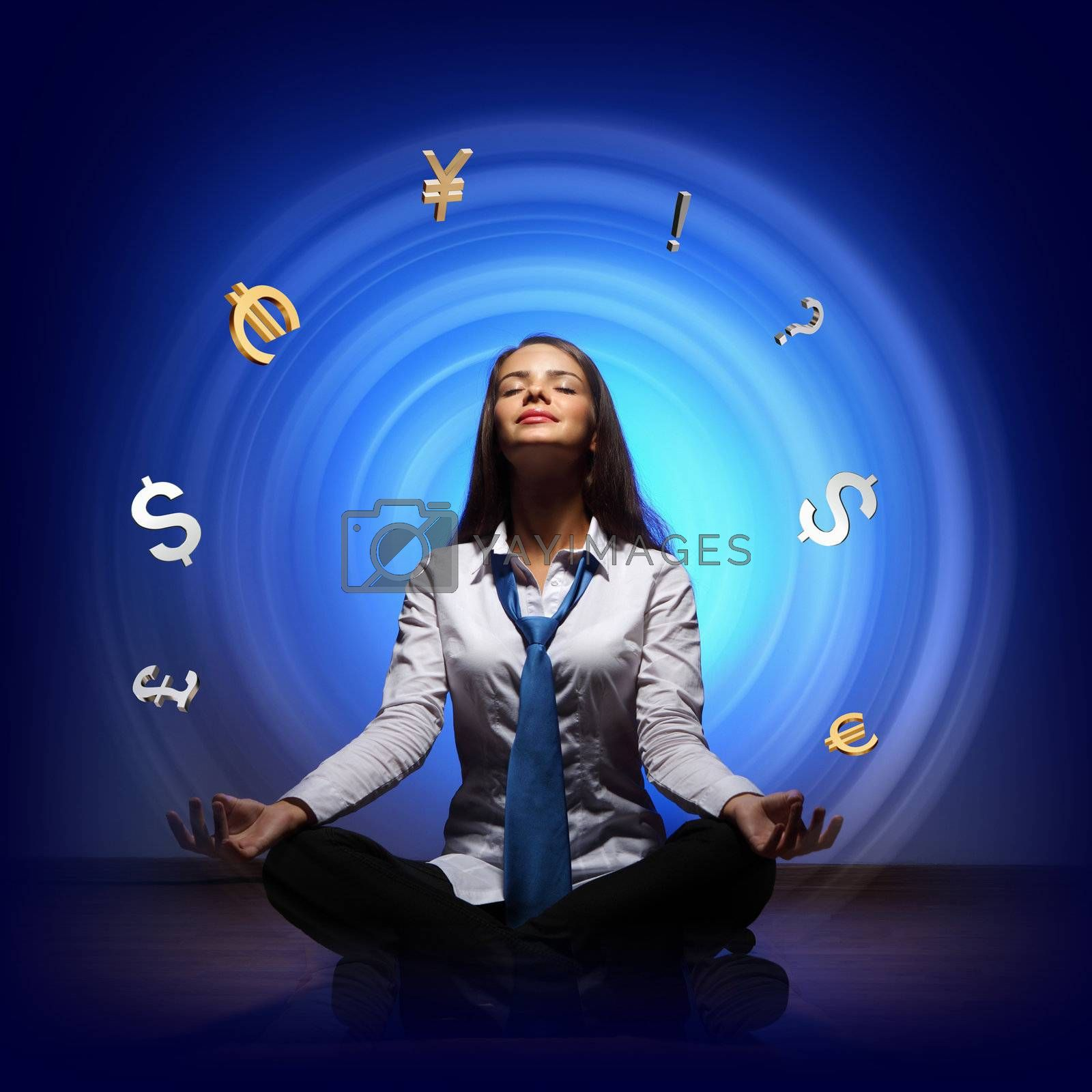 Businesswoman with financial symbols around her on the background