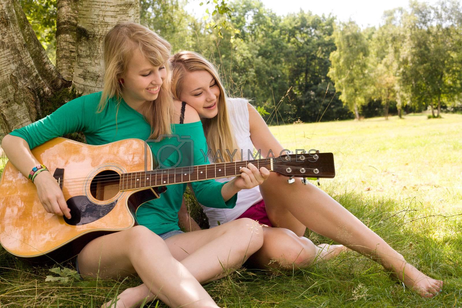 Two girls are having fun in the summer sun