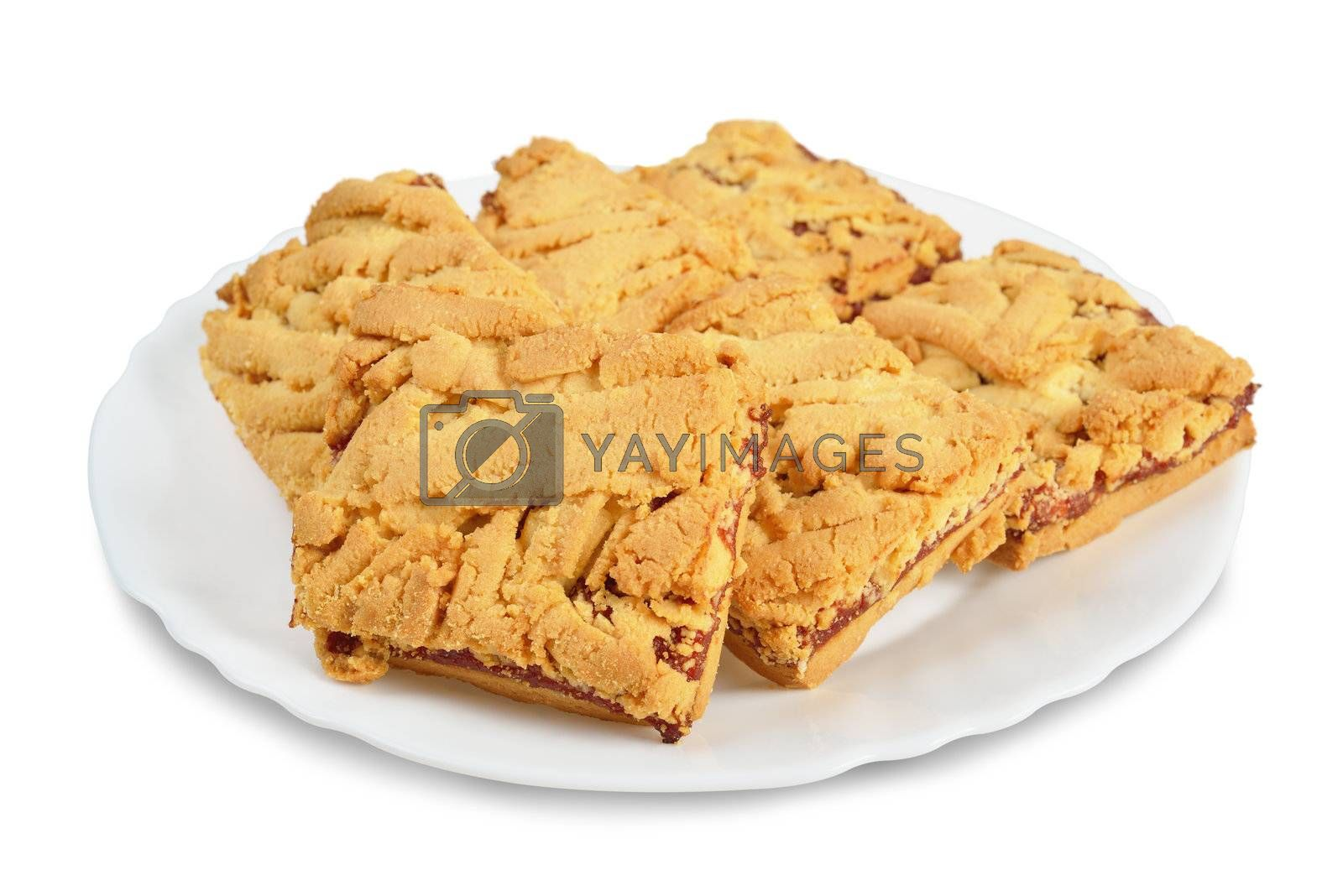 Saucer with a few cookies. Isolated on white.