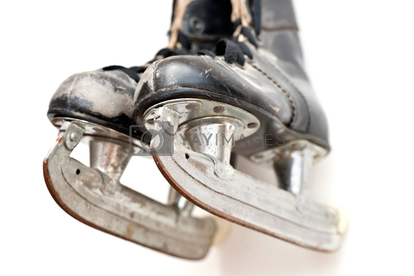 Old hockey skates hanging on the wall