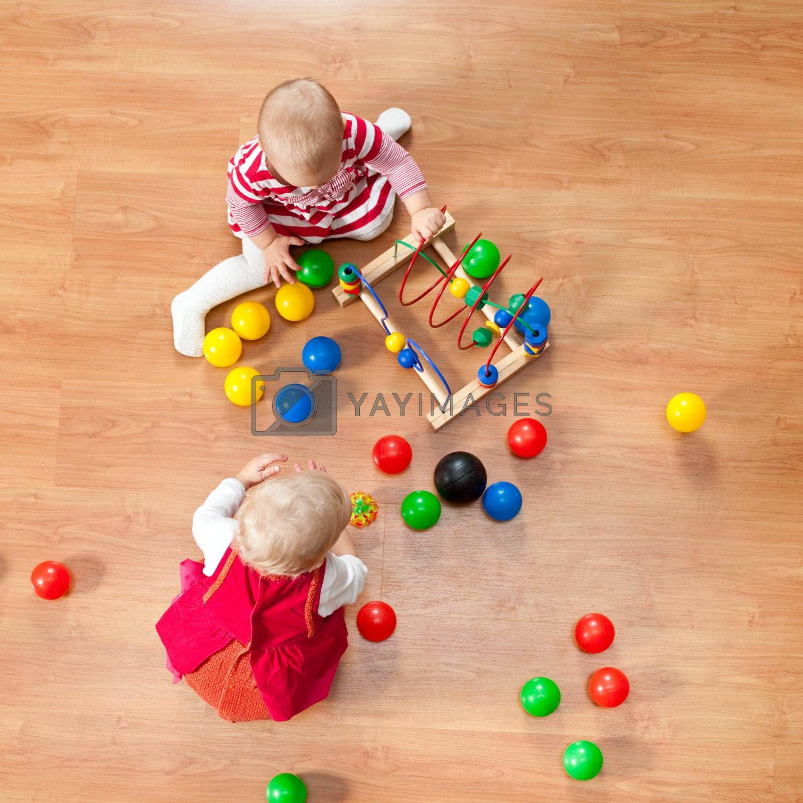 Top view of little girls playing on the floor