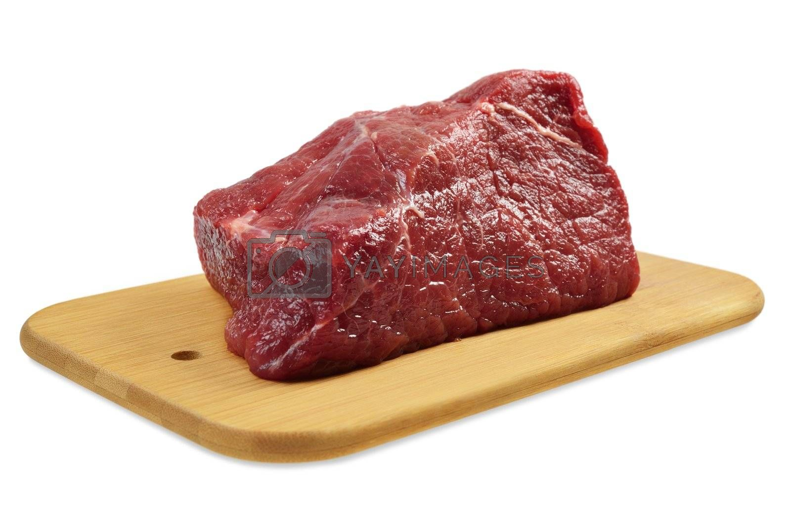 Beef on a wooden board. Isolated on white