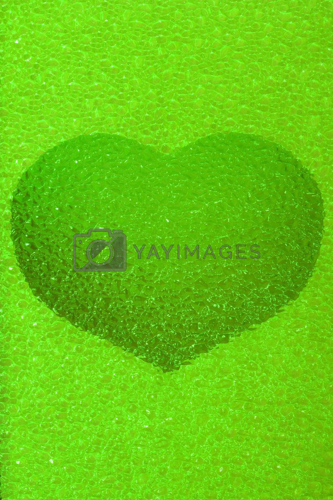 frozen emerald (green) heart with crystals in 3d