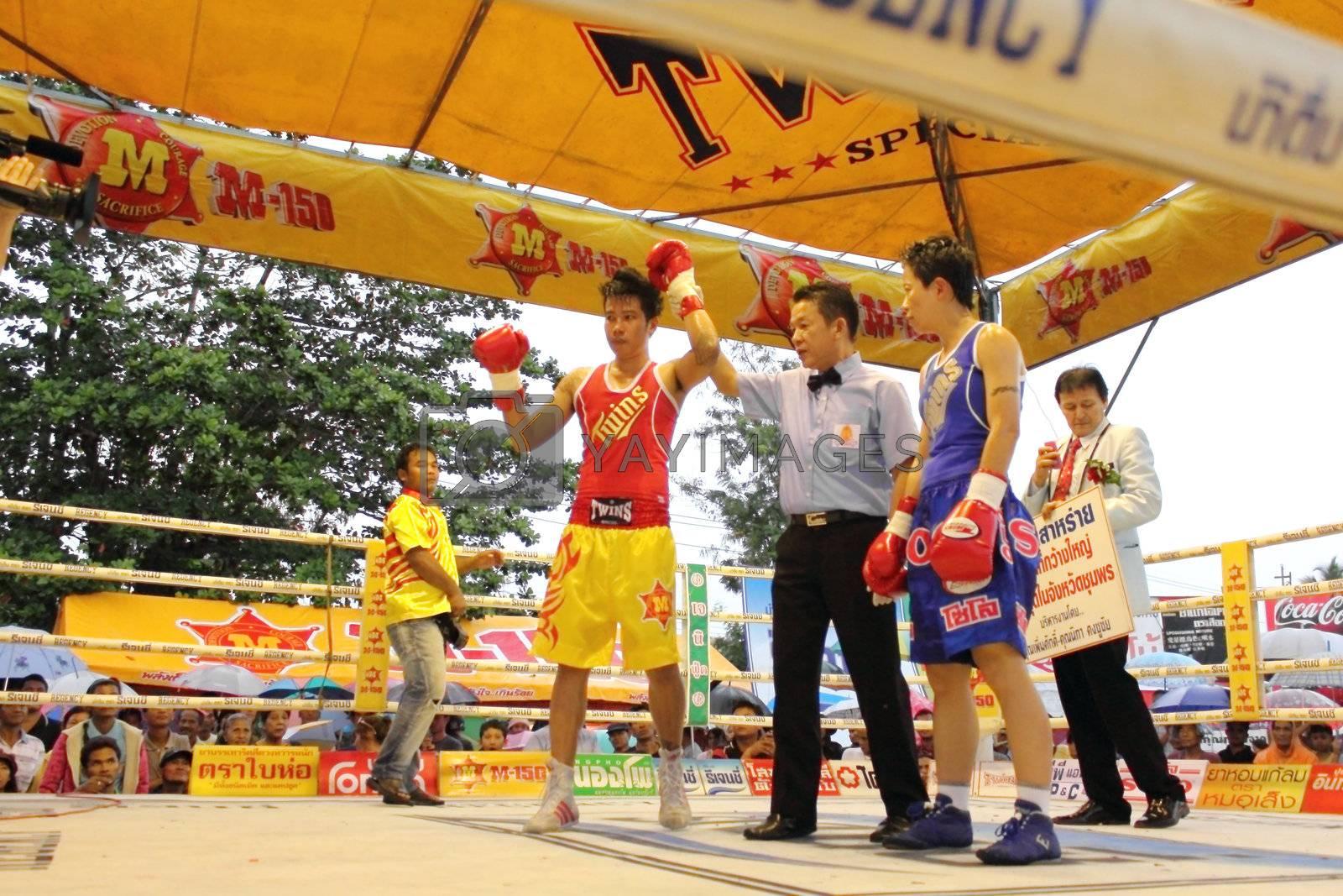 SURAT THANI, THAILAND - DECEMBER 14 : Usanakorn Kokietgym WBC Super Flyweight Champion wins fight boxing over Leeyunting on December 14, 2012 in Surat Thani, Thailand.