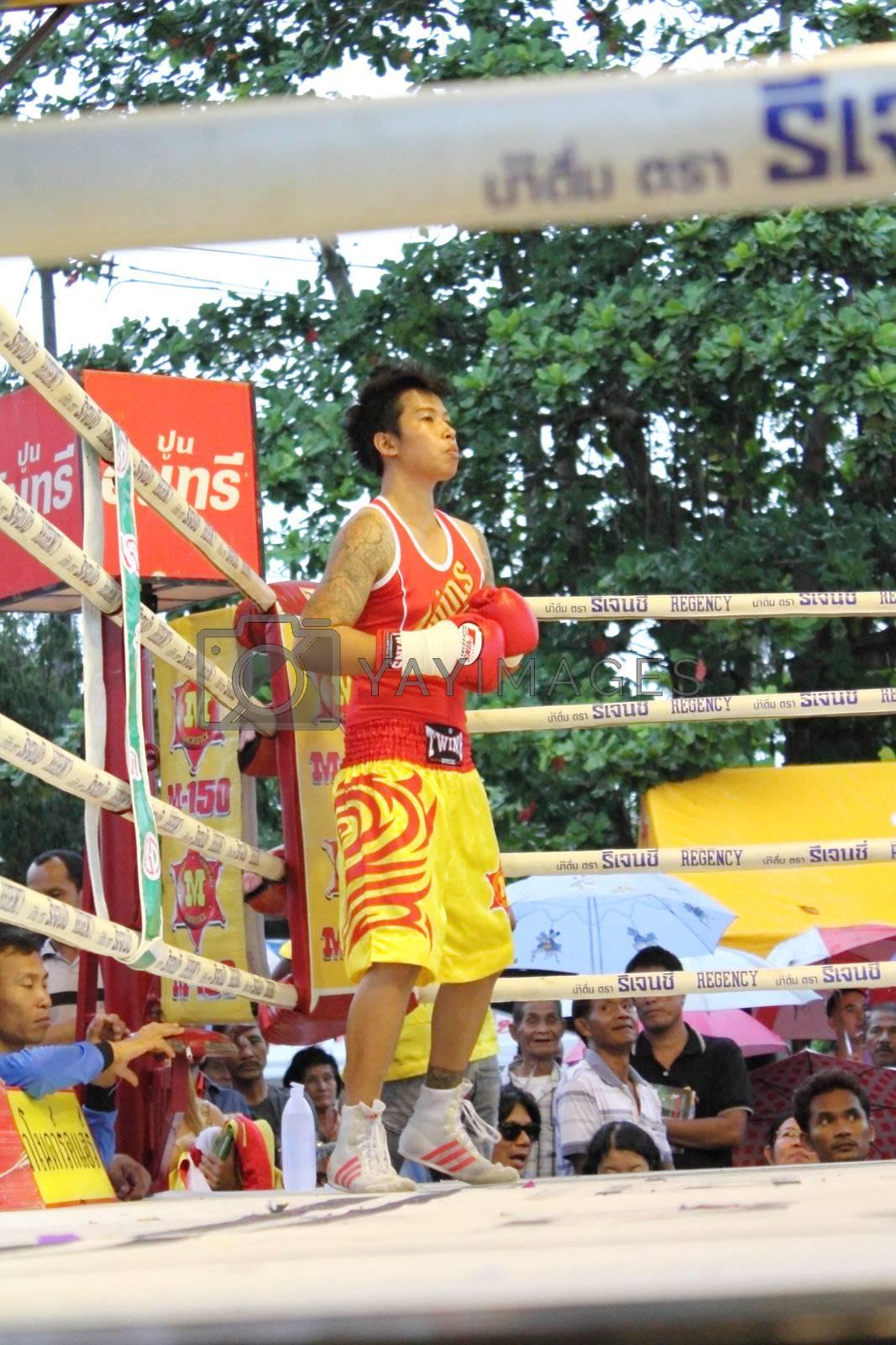 SURAT THANI, THAILAND - DECEMBER 14 : Usanakorn Kokietgym WBC Super Flyweight Champion wait to fight boxig with Leeyunting  on December 14, 2012 in Surat Thani, Thailand.