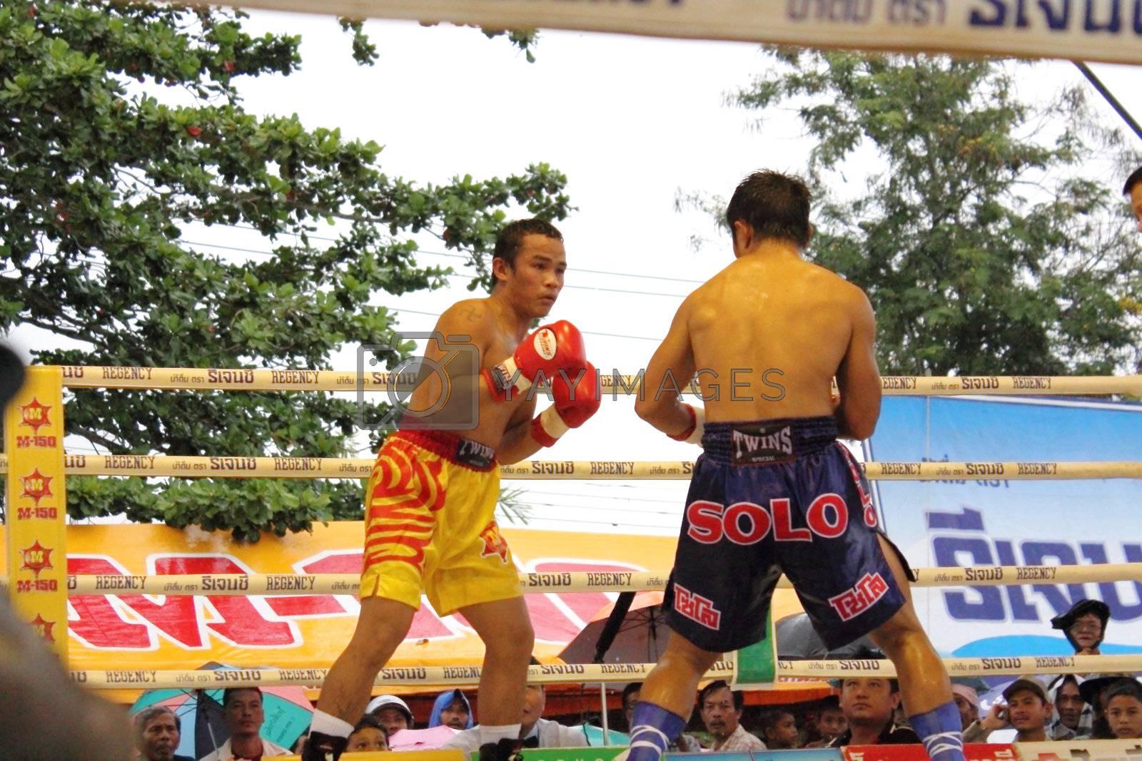 SURAT THANI, THAILAND - DECEMBER 14 : Ratchasak Sitmoaseng and Shucheelhong fight boxing on December 14, 2012 in Surat Thani, Thailand.