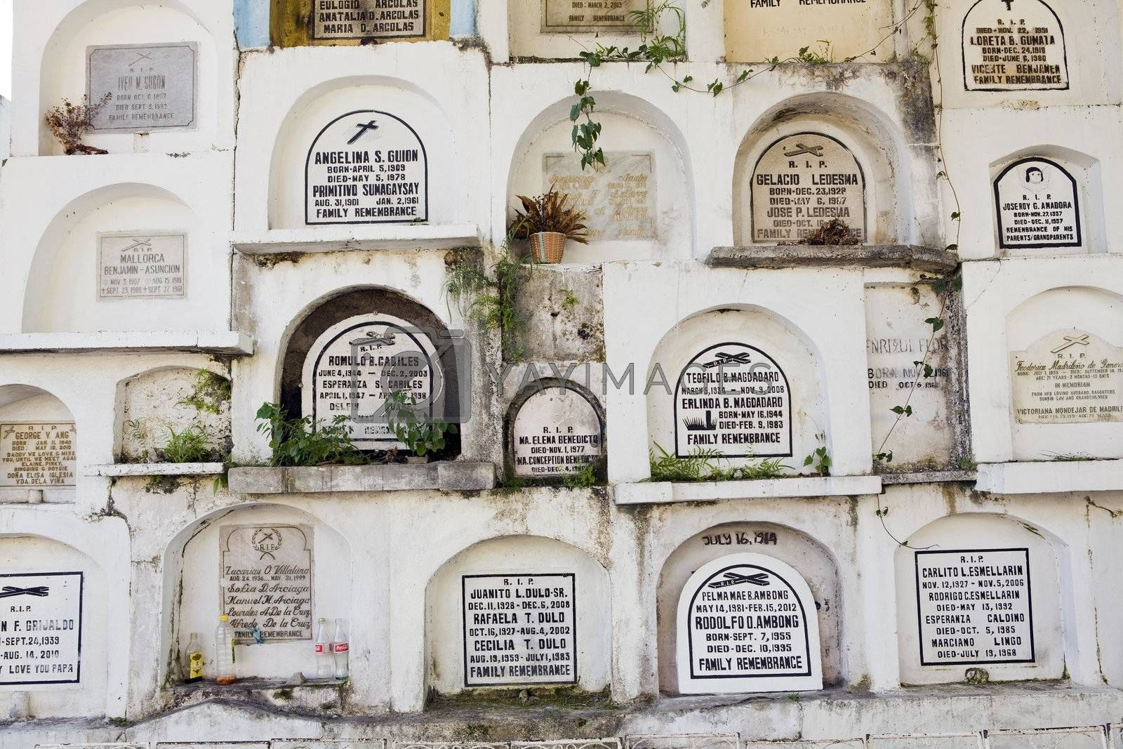 Concrete cemetary crypts stacked many levels high in a Philippine cemetery.