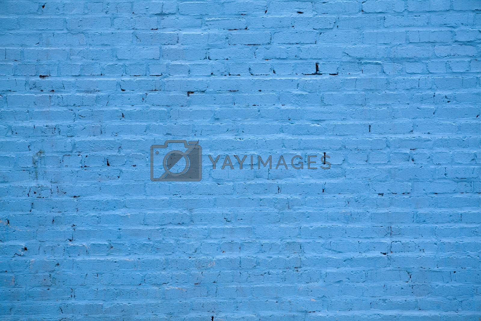 Background - building wall made of blue painted bricks.