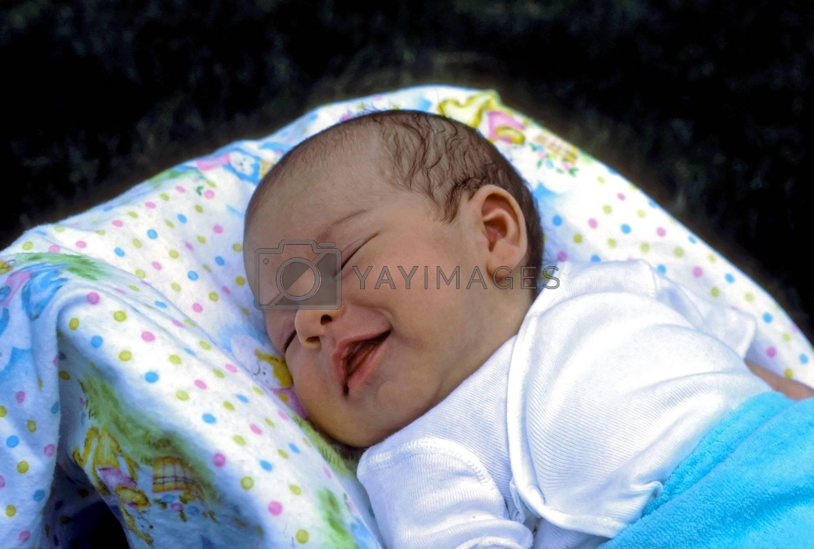 Newborn baby smiling in his sleep.