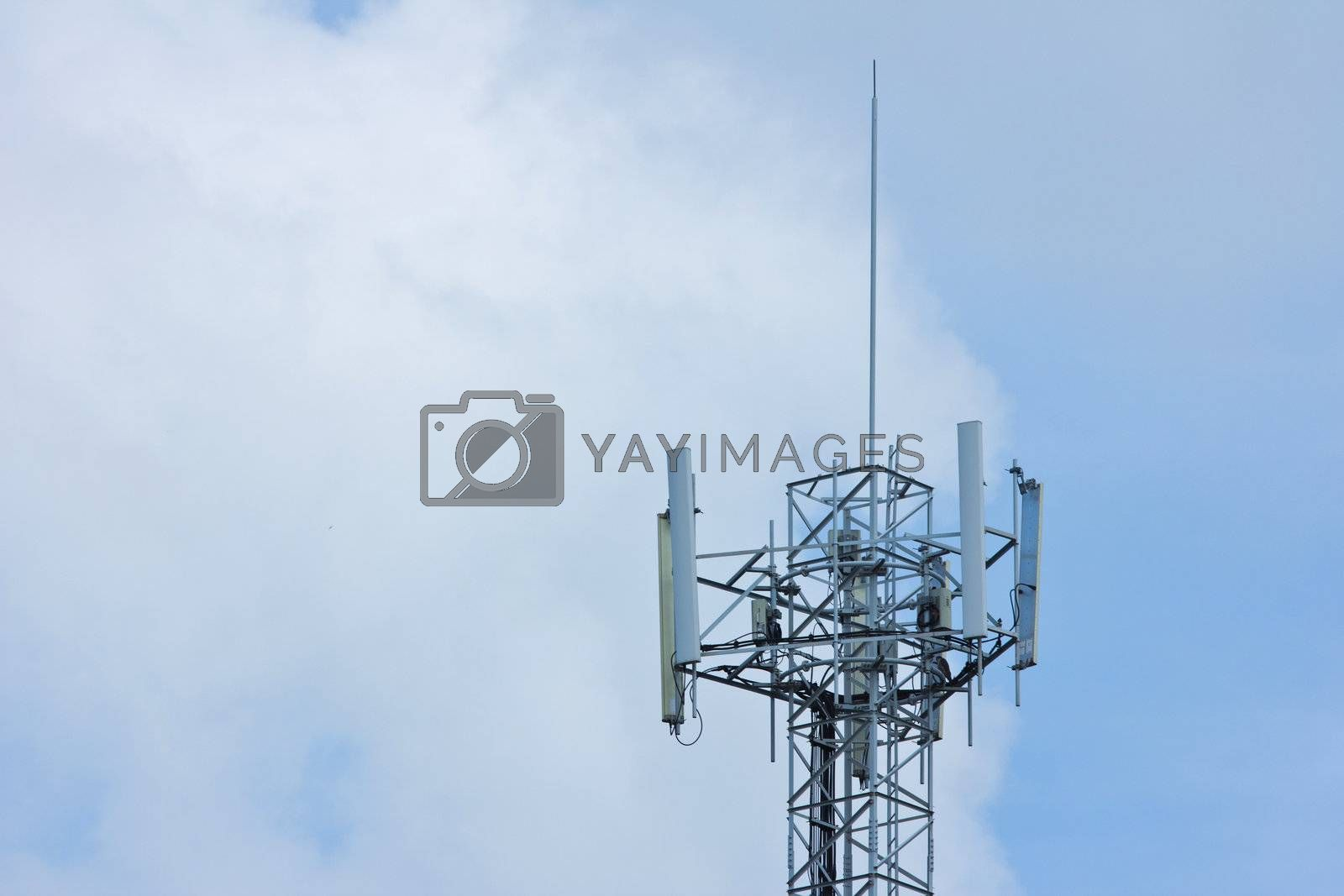 Communication tower over a blue sky background