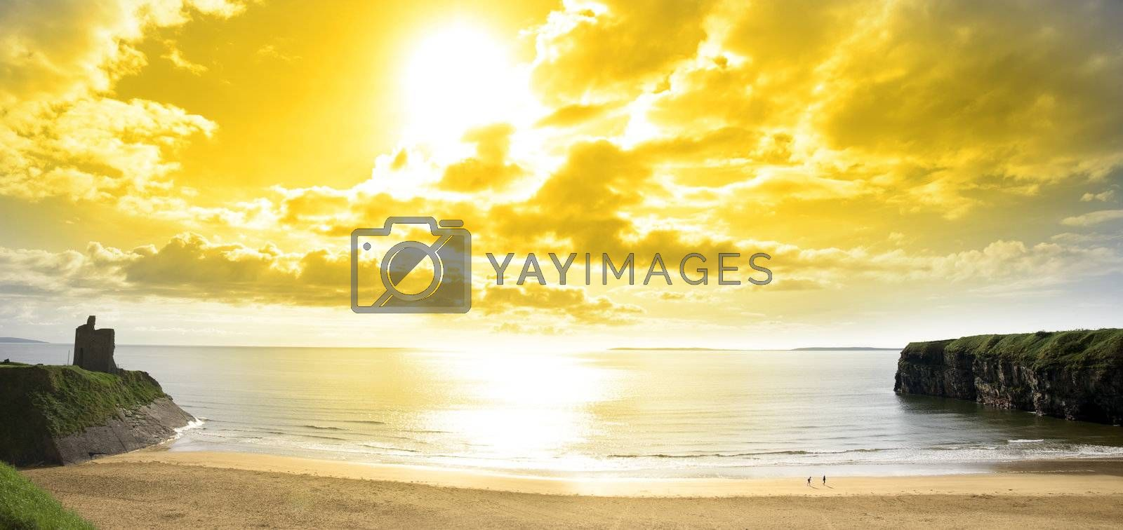 panorama of a Beautiful yellow sun over the Ballybunion beach and castle in Ireland one summers day